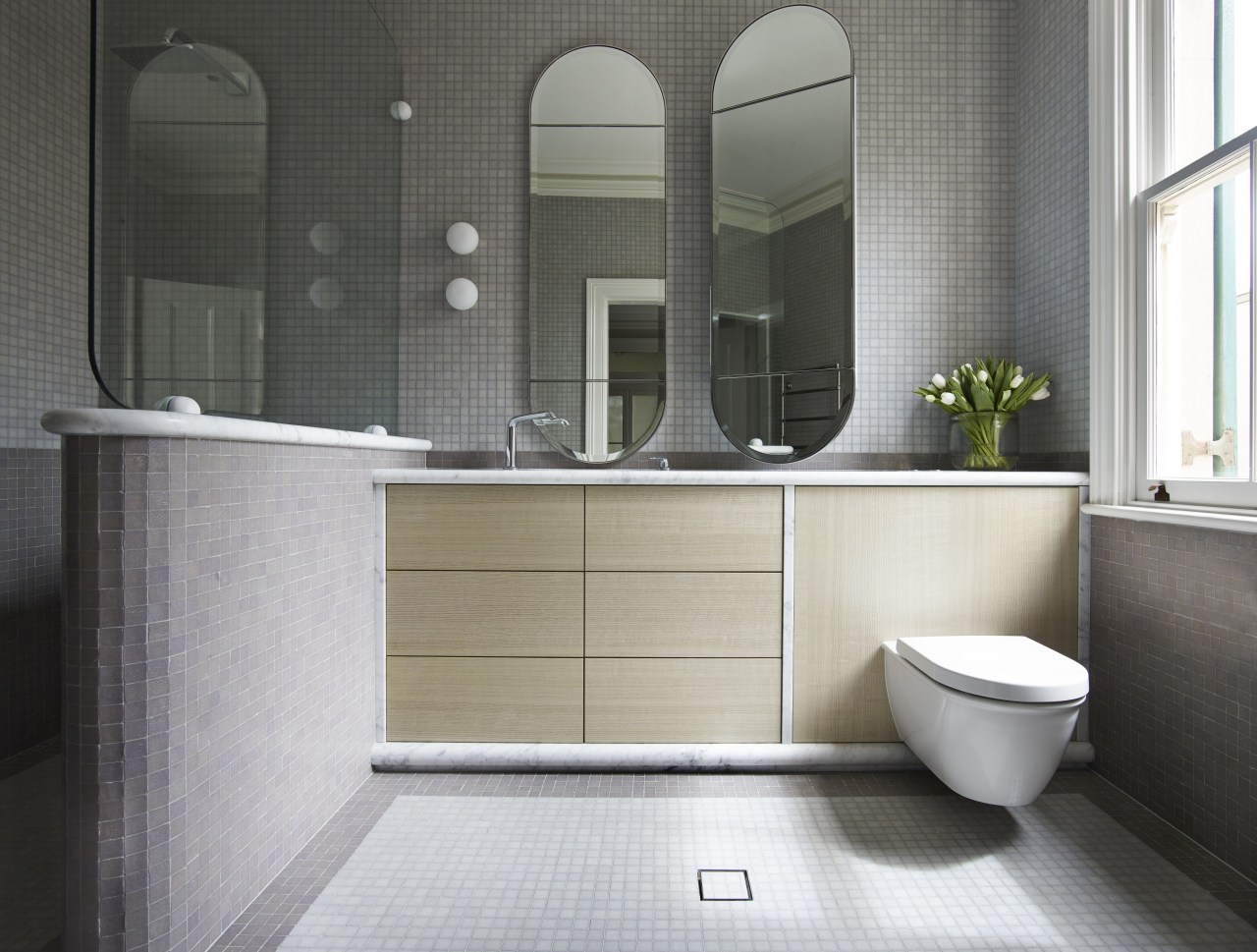 This ensuite has a near-identical aesthetic to the bathroom, bathroom accessory, floor, interior design, plumbing fixture, product design, room, sink, tile, gray