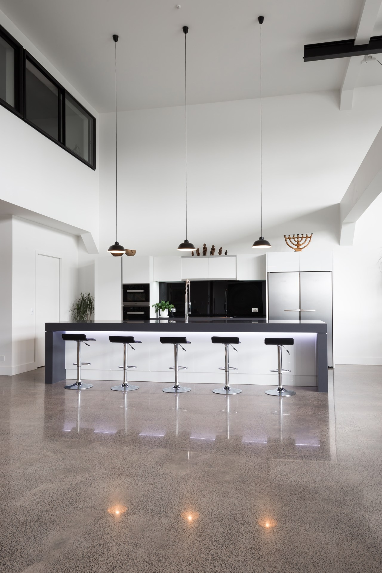 LED lights above the cabinets and under the architecture, ceiling, countertop, floor, flooring, furniture, interior design, kitchen, loft, product design, table, gray