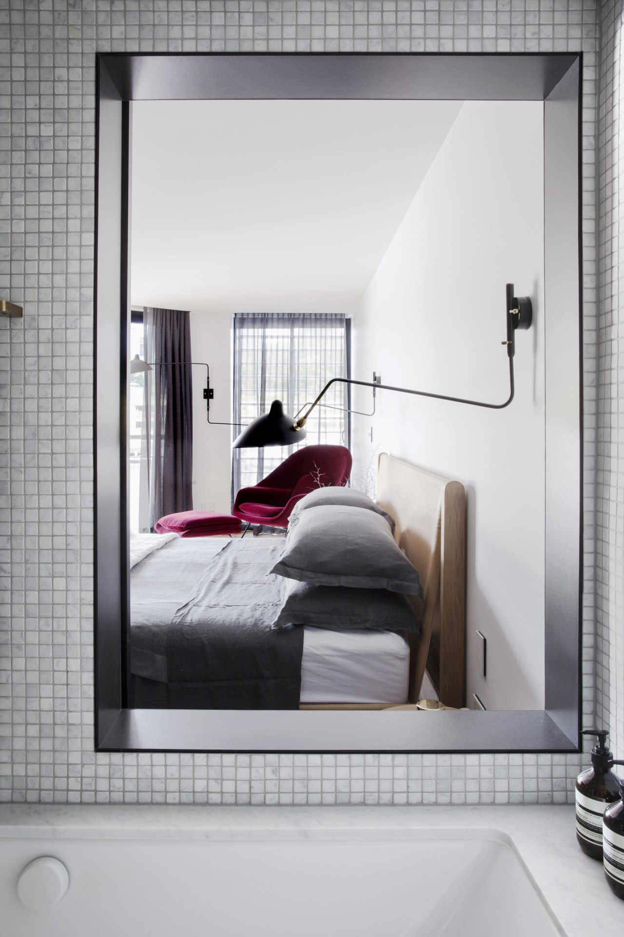 This view from within the bathing pod of bed, bed frame, door, furniture, home, interior design, room, window, gray