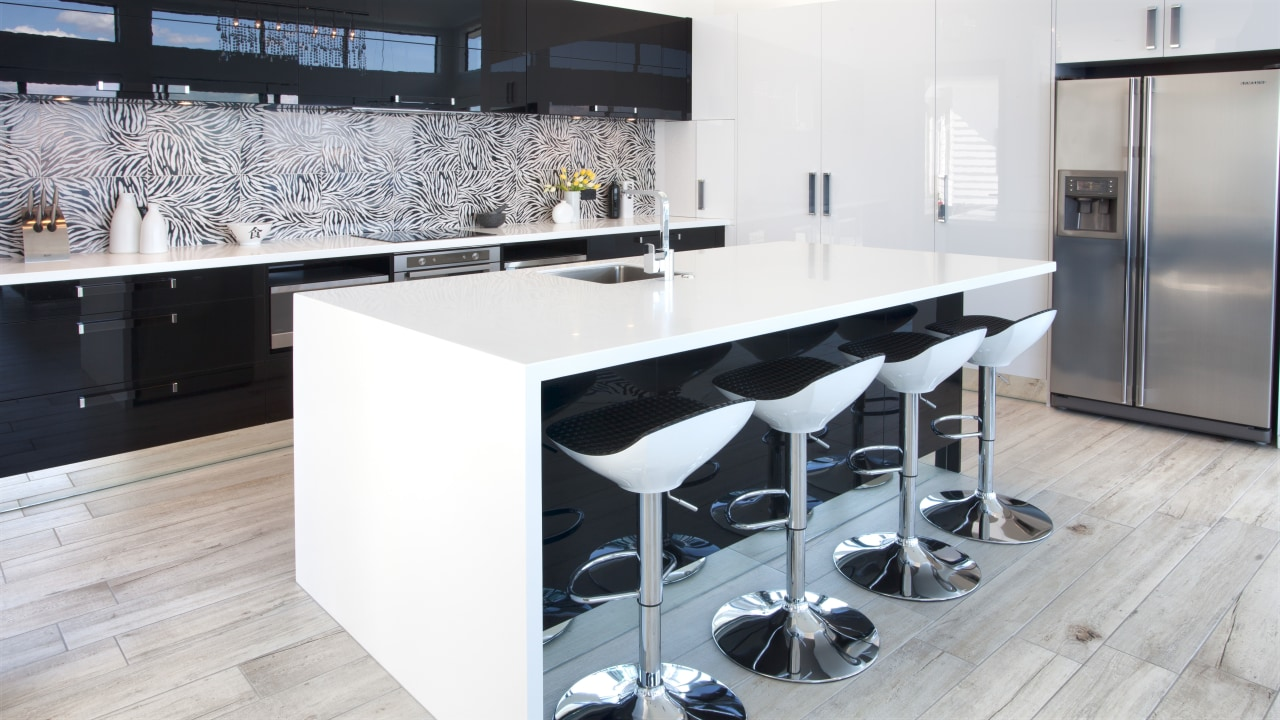 Crisp white Corian countertops and black high gloss countertop, floor, flooring, interior design, kitchen, product design, white
