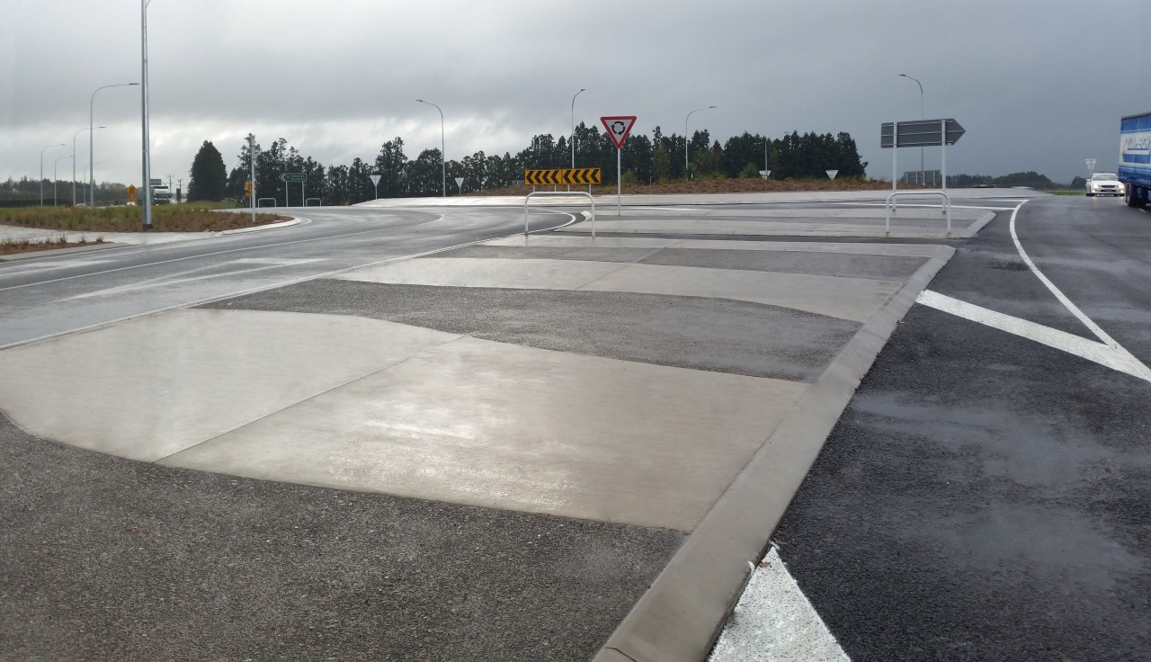A traffic circle near Hamilton airport benefits from asphalt, lane, road, road surface, gray