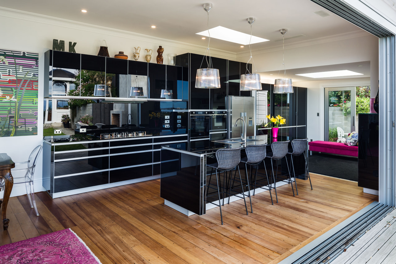 Even the splashback and countertop are in black flooring, interior design, kitchen, real estate, gray, black
