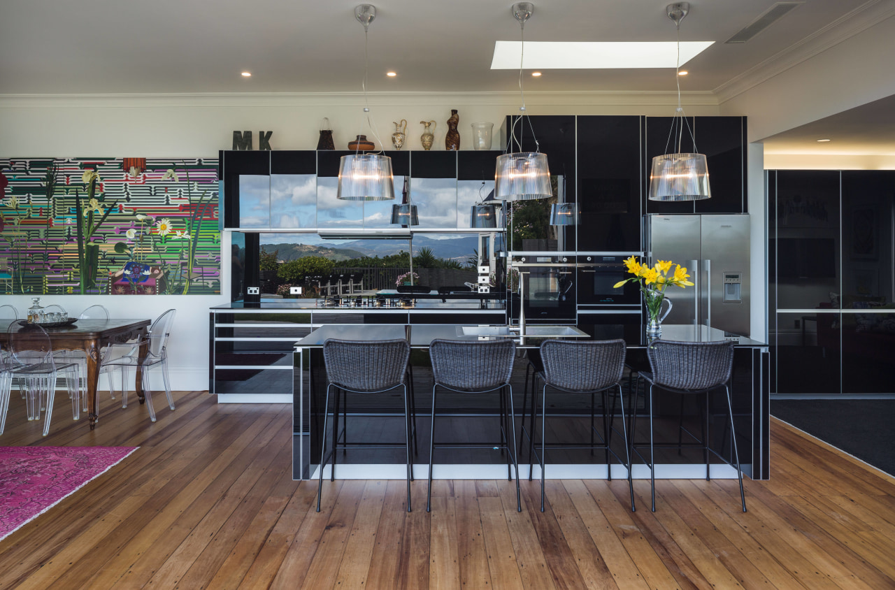 This kitchens black, reflective cabinetry runs on into floor, flooring, interior design, kitchen, real estate, gray, black