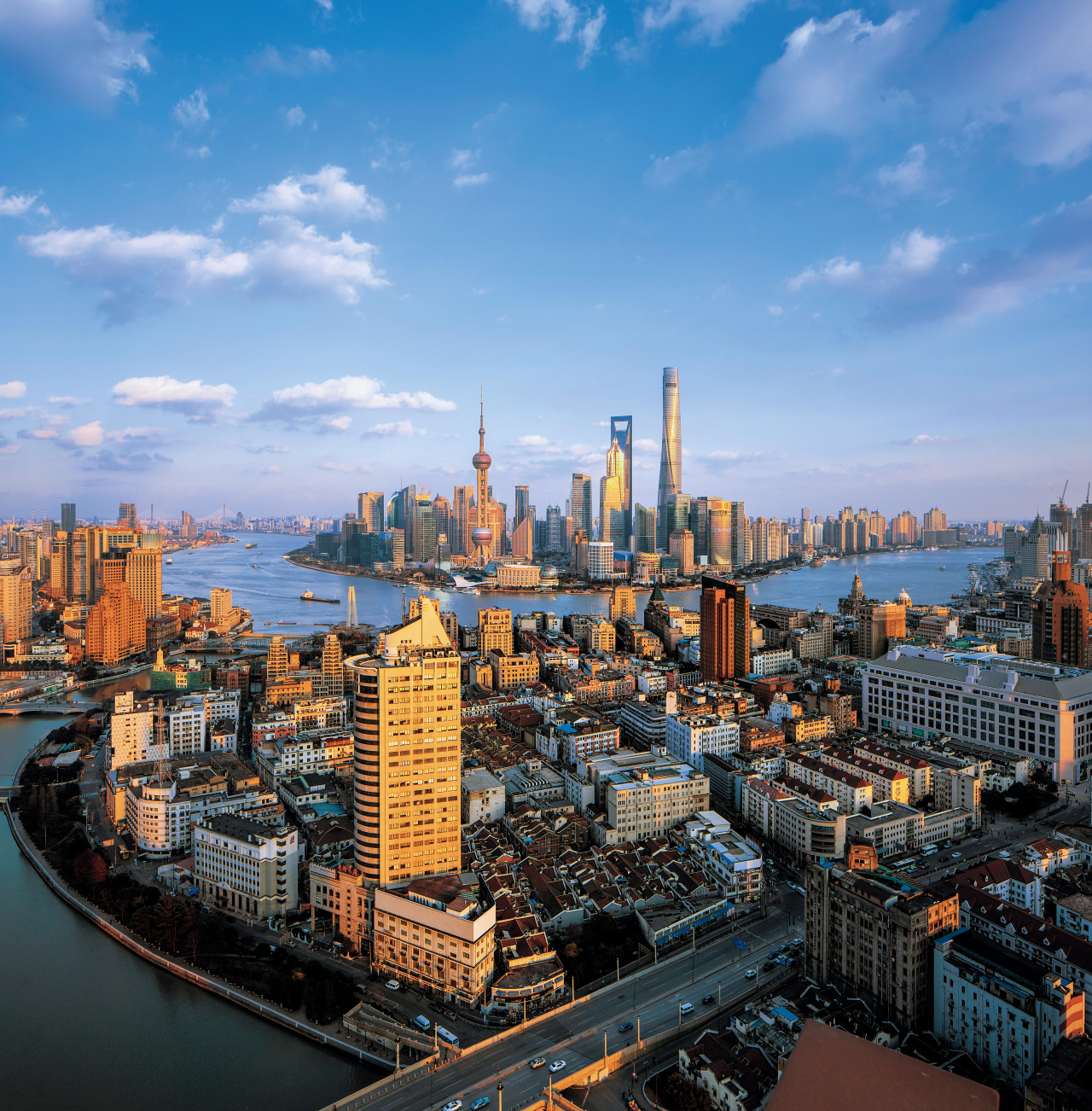 The Shanghai Tower became Chinas tallest and the aerial photography, bird's eye view, building, city, cityscape, daytime, downtown, horizon, landmark, metropolis, metropolitan area, reflection, sky, skyline, skyscraper, tower, tower block, urban area, teal, black
