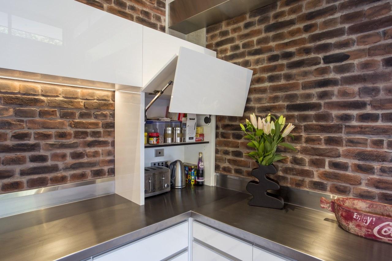 Raised aesthetic this appliance garage fold-up door screens countertop, interior design, kitchen, loft, real estate, brown, white