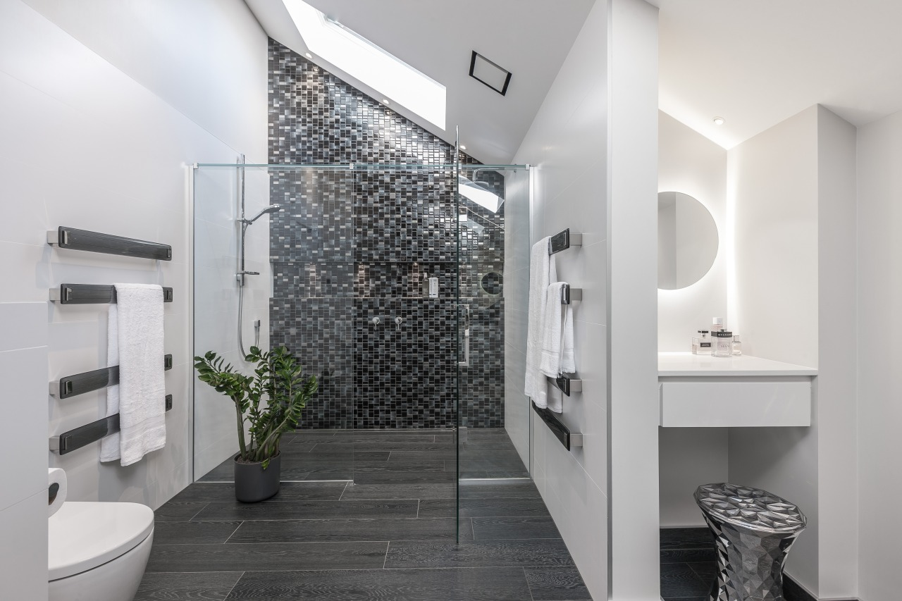 Multiple light sources and twinkling mosaics give this architecture, bathroom, floor, home, interior design, product design, room, tile, white, gray