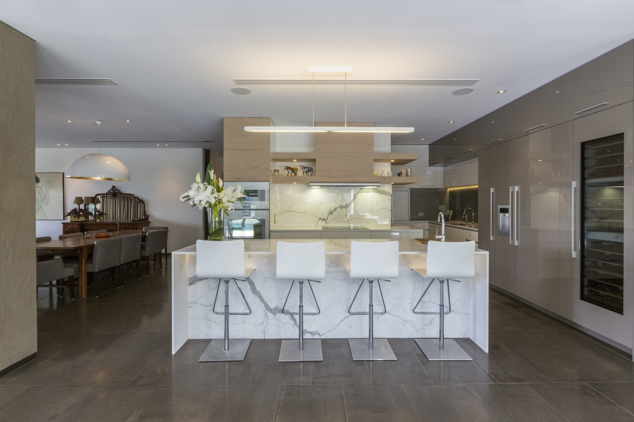 A long suspended light provides bright task lighting floor, flooring, house, interior design, kitchen, real estate, table, gray