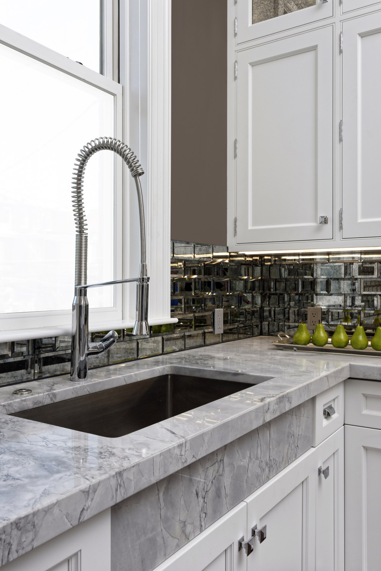 Everything is on the tall side in this countertop, kitchen, sink, tap, white, gray