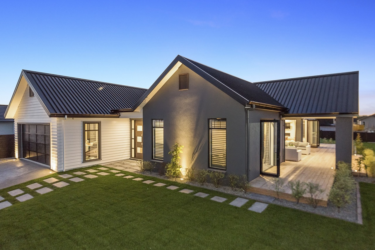 Clad in complementary, low-upkeep Scyon weatherboard and grey cottage, elevation, estate, facade, farmhouse, home, house, property, real estate, residential area, siding, brown, teal