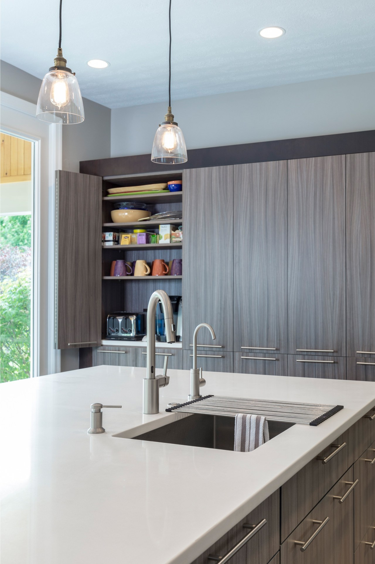This kitchen by Lauren Levant Interior has an cabinetry, countertop, interior design, kitchen, gray