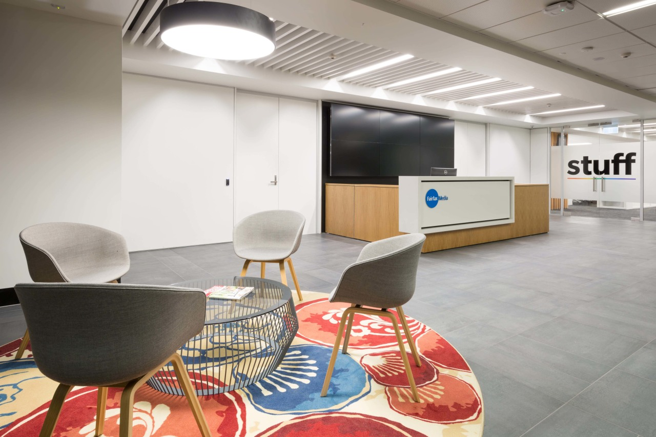 A large digital screen backs the white and ceiling, chair, conference hall, floor, furniture, interior design, office, product design, table, white, gray