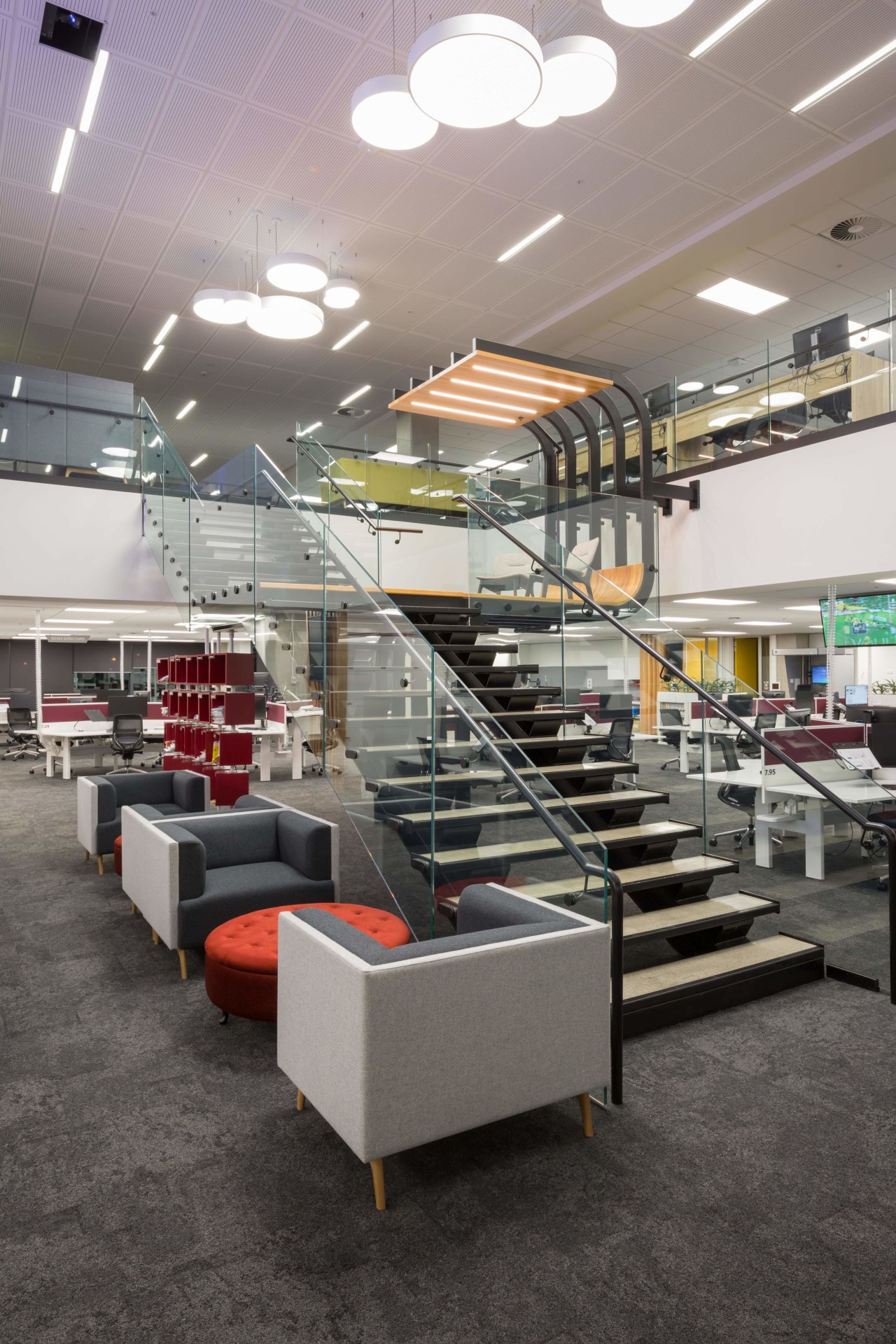 Tse Architects designed the stair and breakout landing institution, interior design, retail, gray, black