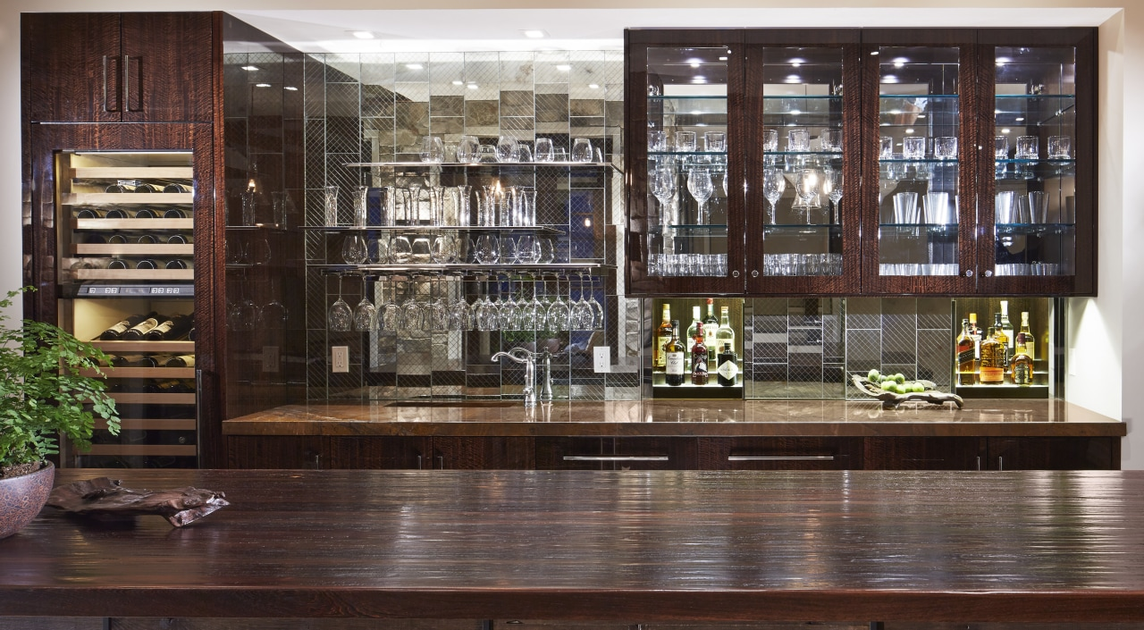 Mick De Giulio also designed this bar alongside bookcase, cabinetry, furniture, interior design, liquor store, lobby, shelving, red