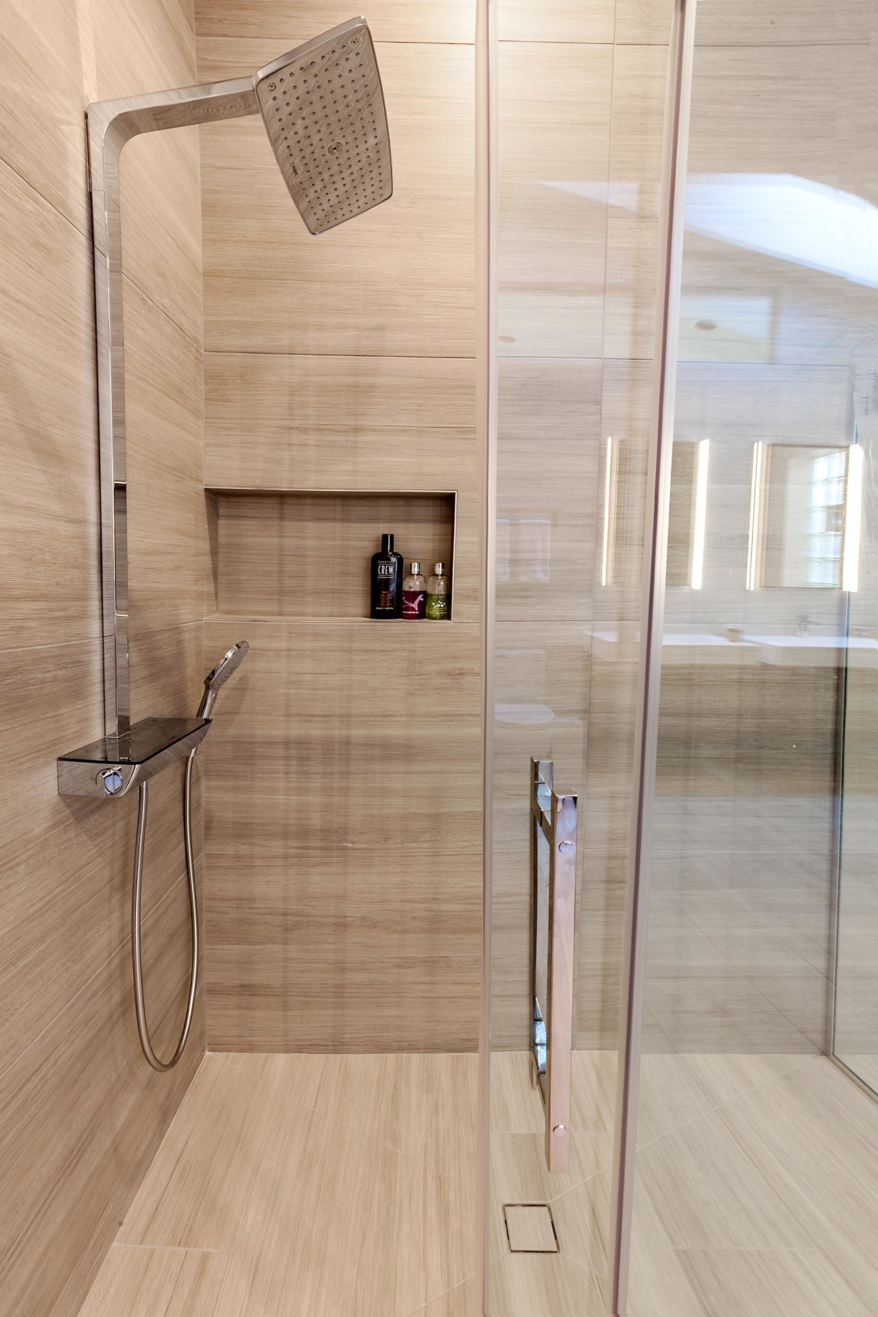 Building out one wall of this shower allowed bathroom, floor, flooring, plumbing fixture, product design, tap, tile, wall, wood, wood flooring, gray