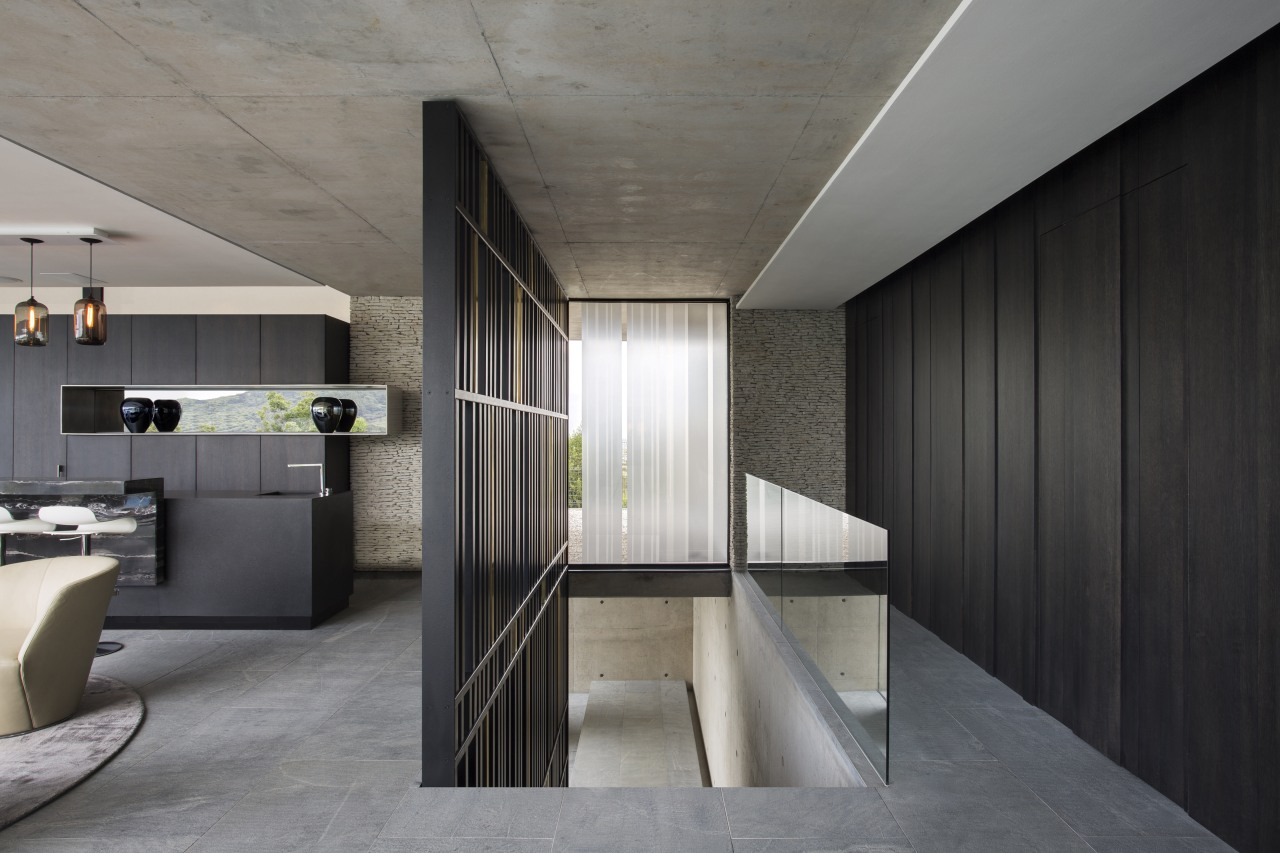 Stairs from the entrance lobby lead to this architecture, house, interior design, gray, black