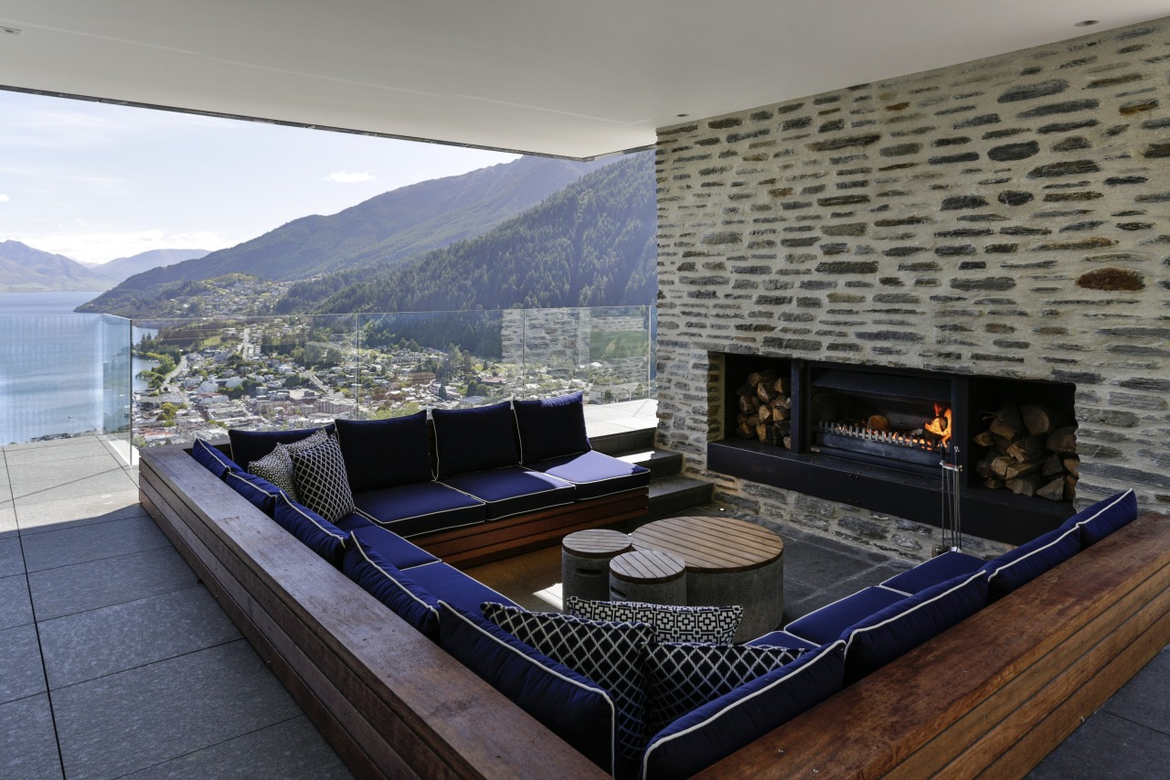This outdoor room in a hillside house by architecture, fireplace, hearth, home, house, interior design, living room, penthouse apartment, property, real estate, gray
