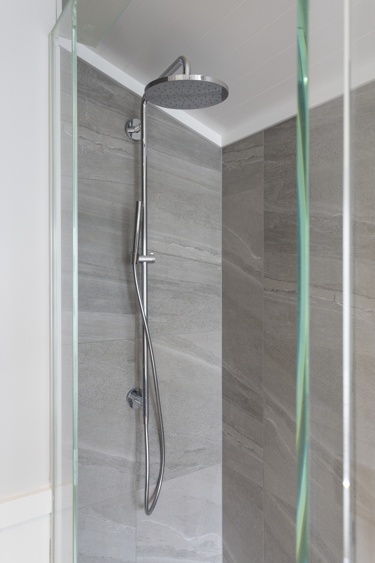 With wall tiles to match the bathrooms floor angle, bathroom, plumbing fixture, product design, shower, tap, gray
