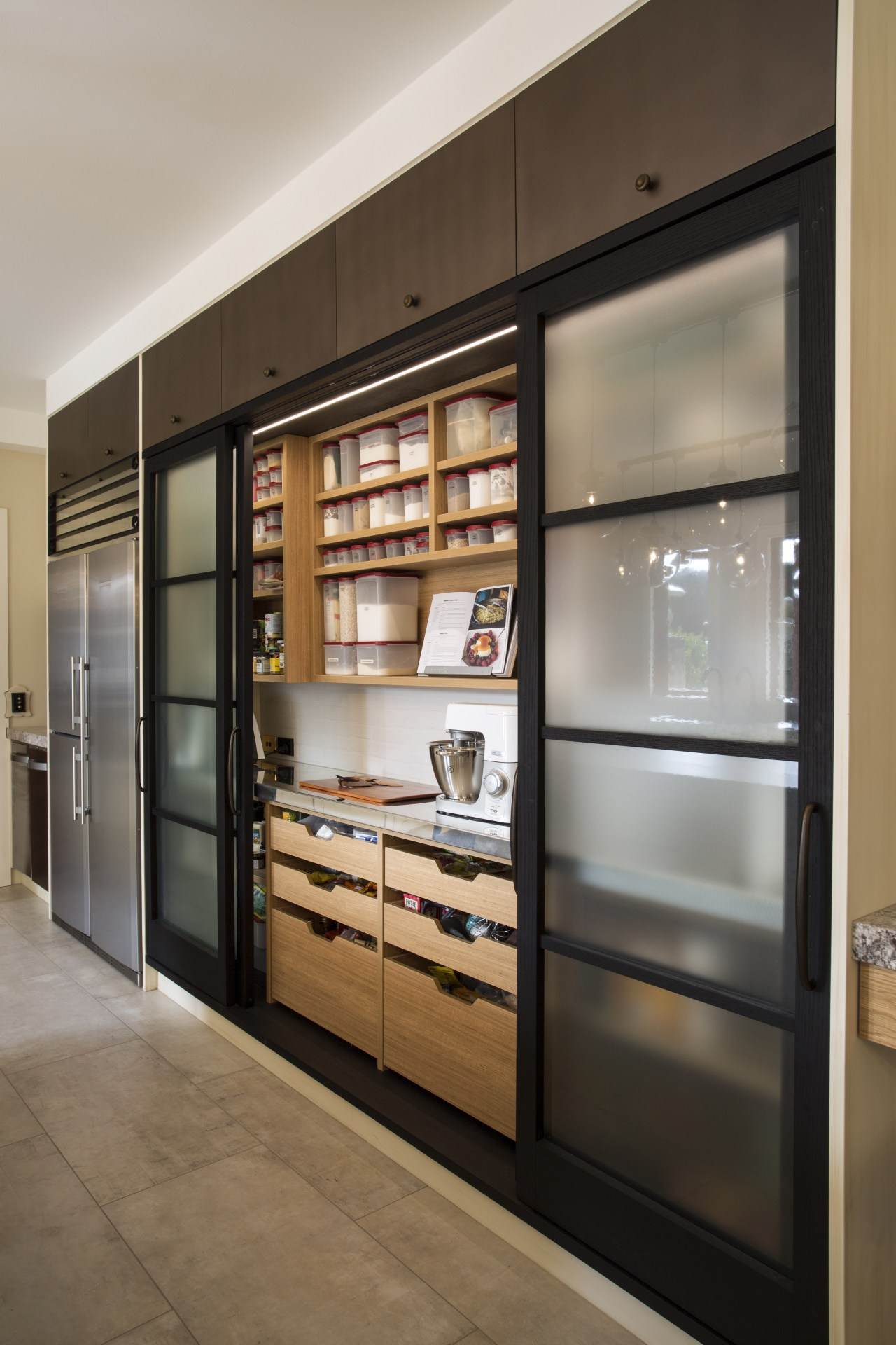 The pantry door frames and large flagstone-like floor cabinetry, display case, furniture, interior design, shelving, gray, brown, black