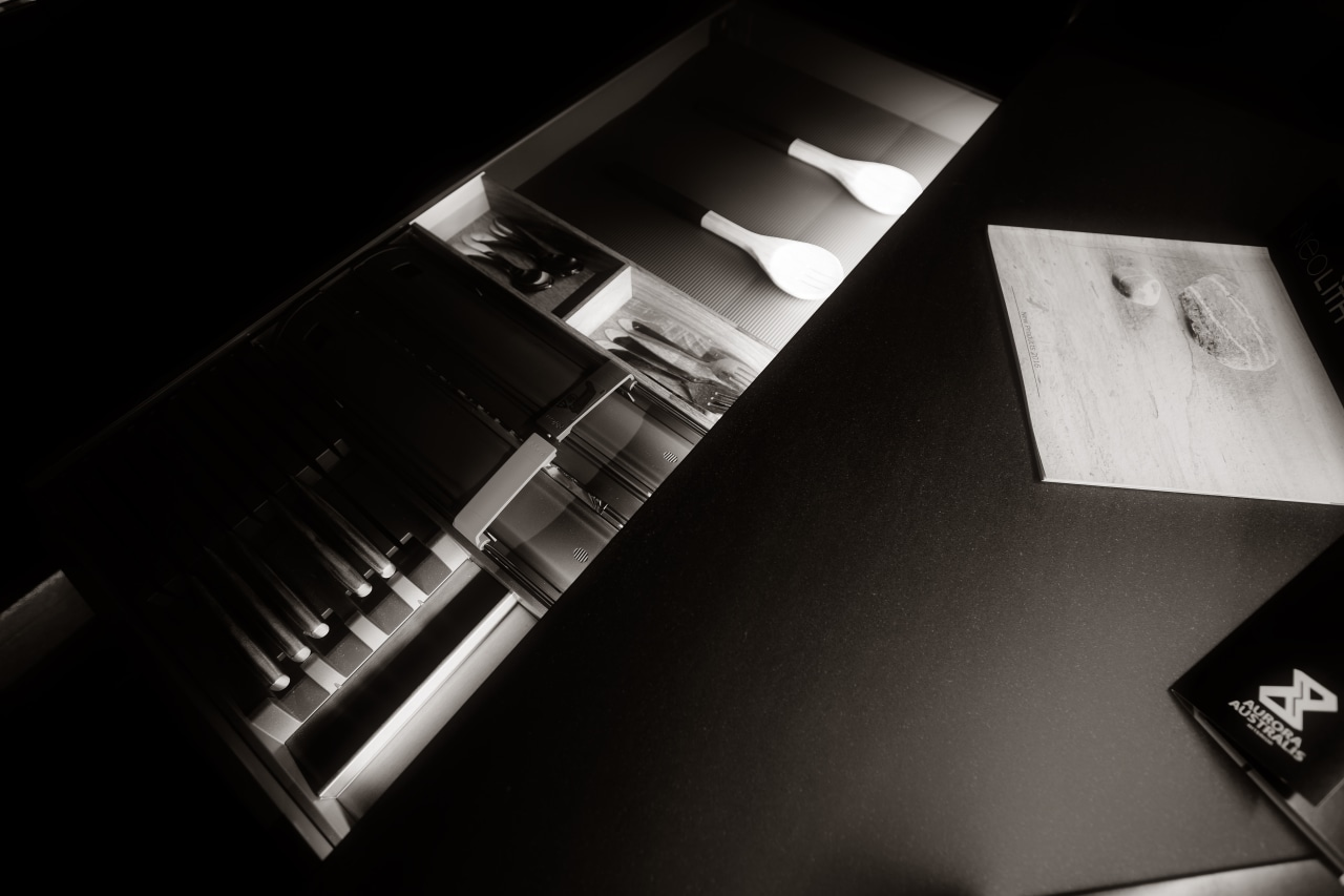 Customised, internally lit drawer interiors are both practical black and white, light, monochrome, monochrome photography, product design, black