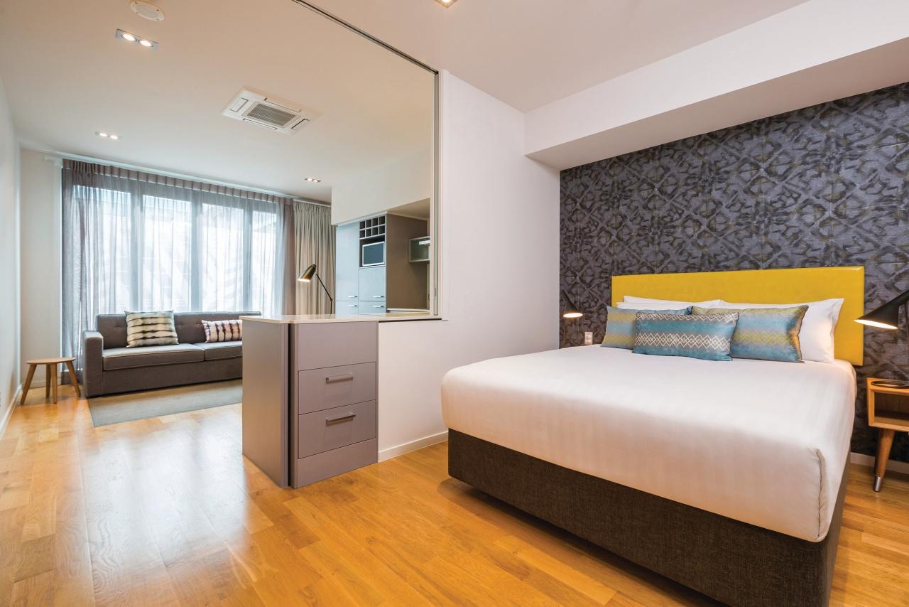 A range of hotel room styles are offered bedroom, ceiling, floor, flooring, hardwood, interior design, property, real estate, room, suite, wood flooring, gray
