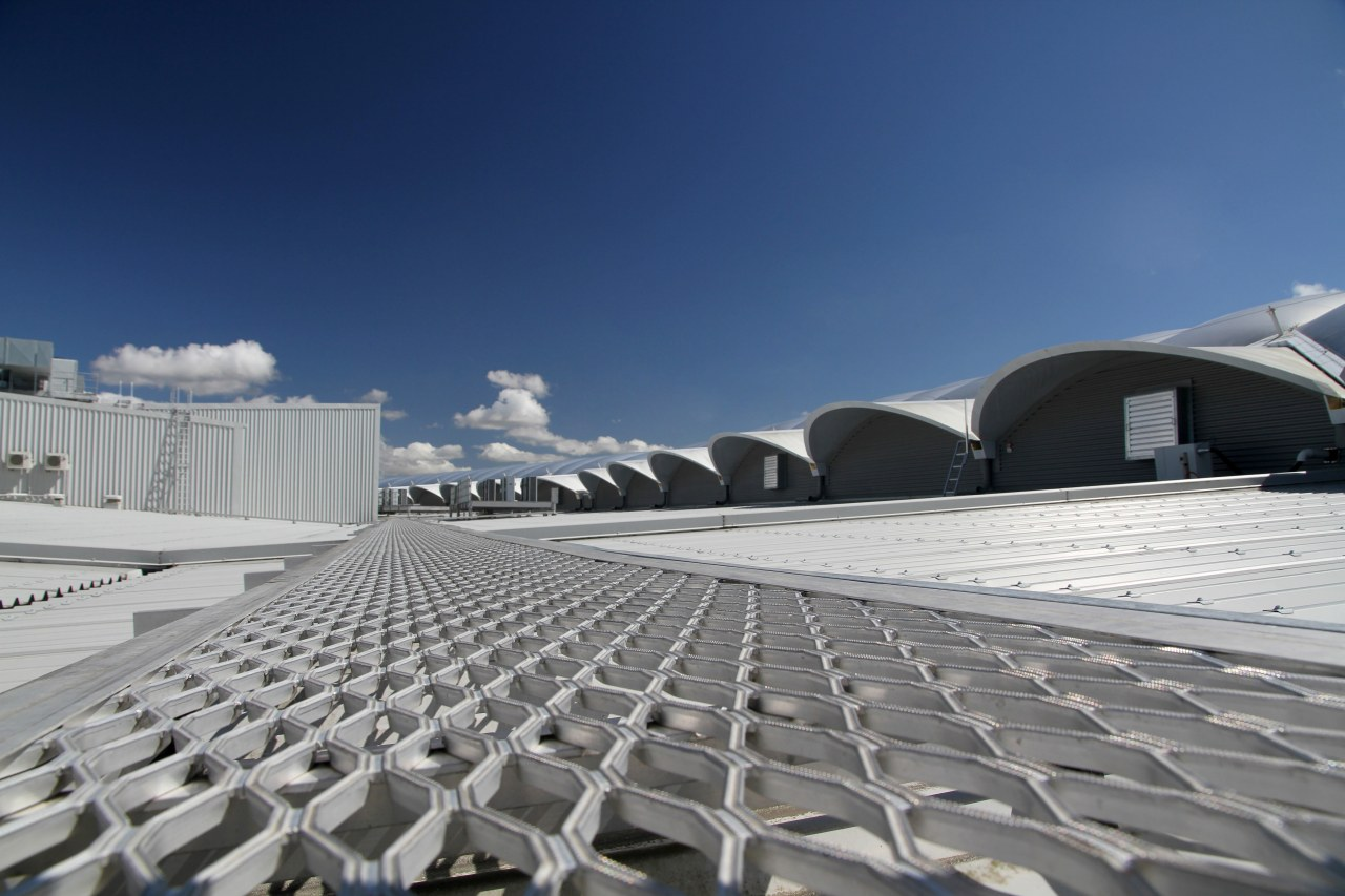 Monkey Toes proprietary brand is in knurled mesh architecture, cloud, daylighting, daytime, roof, sky, sport venue, structure, gray, blue