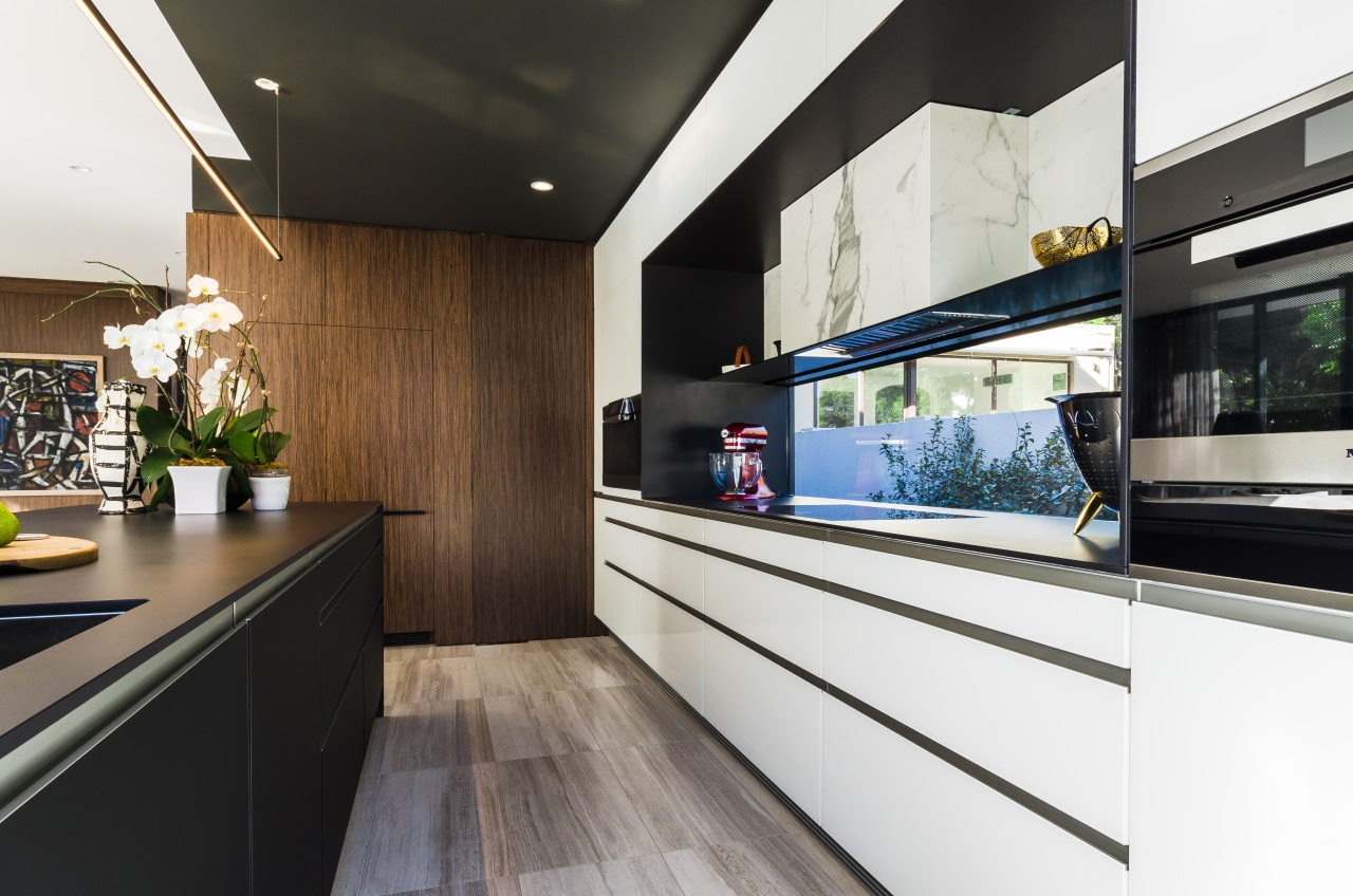On this project by Pepper Design, the existing countertop, interior design, kitchen, black, white