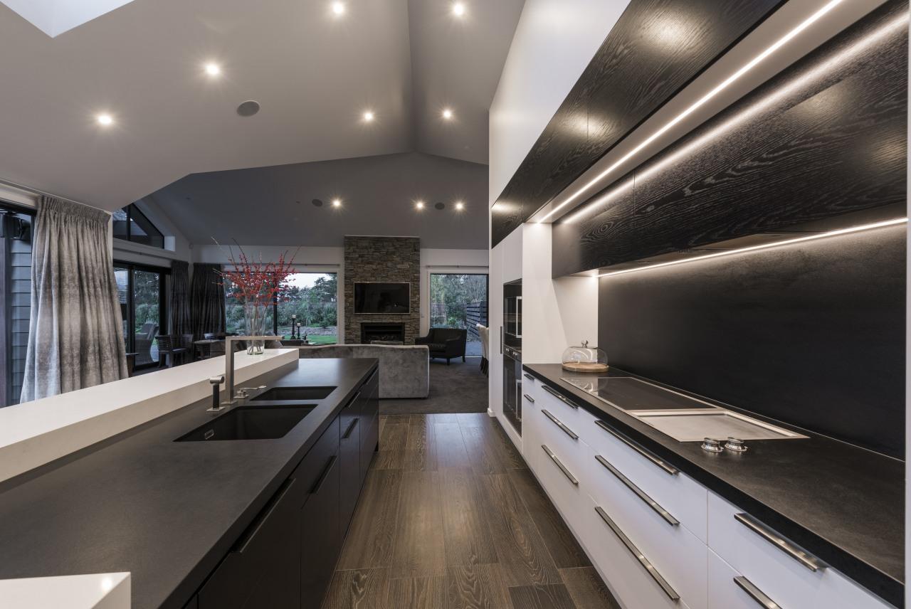 This kitchen by designer Davinia Sutton reflects the ceiling, countertop, interior design, kitchen, gray, black