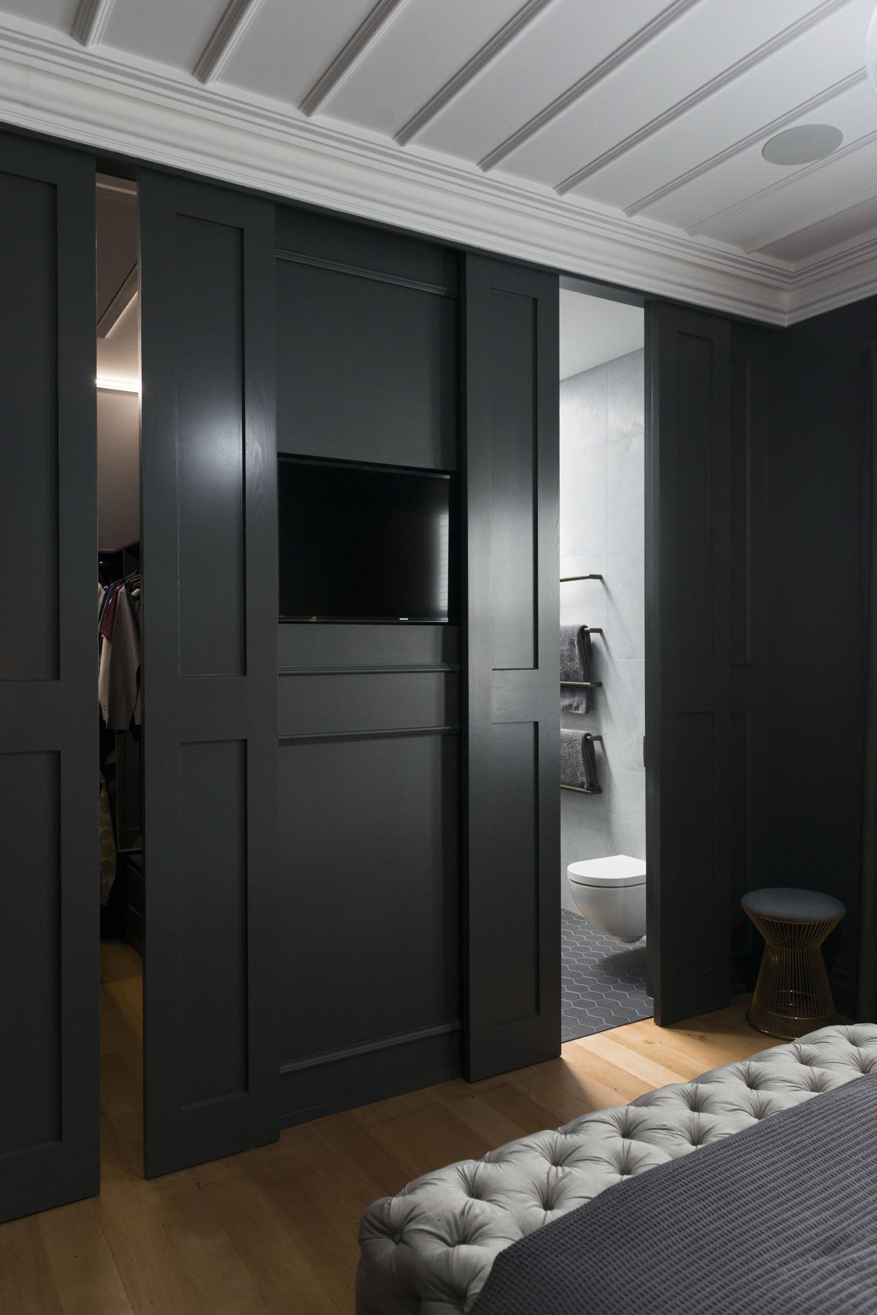 In this master suite makeover, the bedrooms custom door, furniture, interior design, room, wardrobe, black, gray