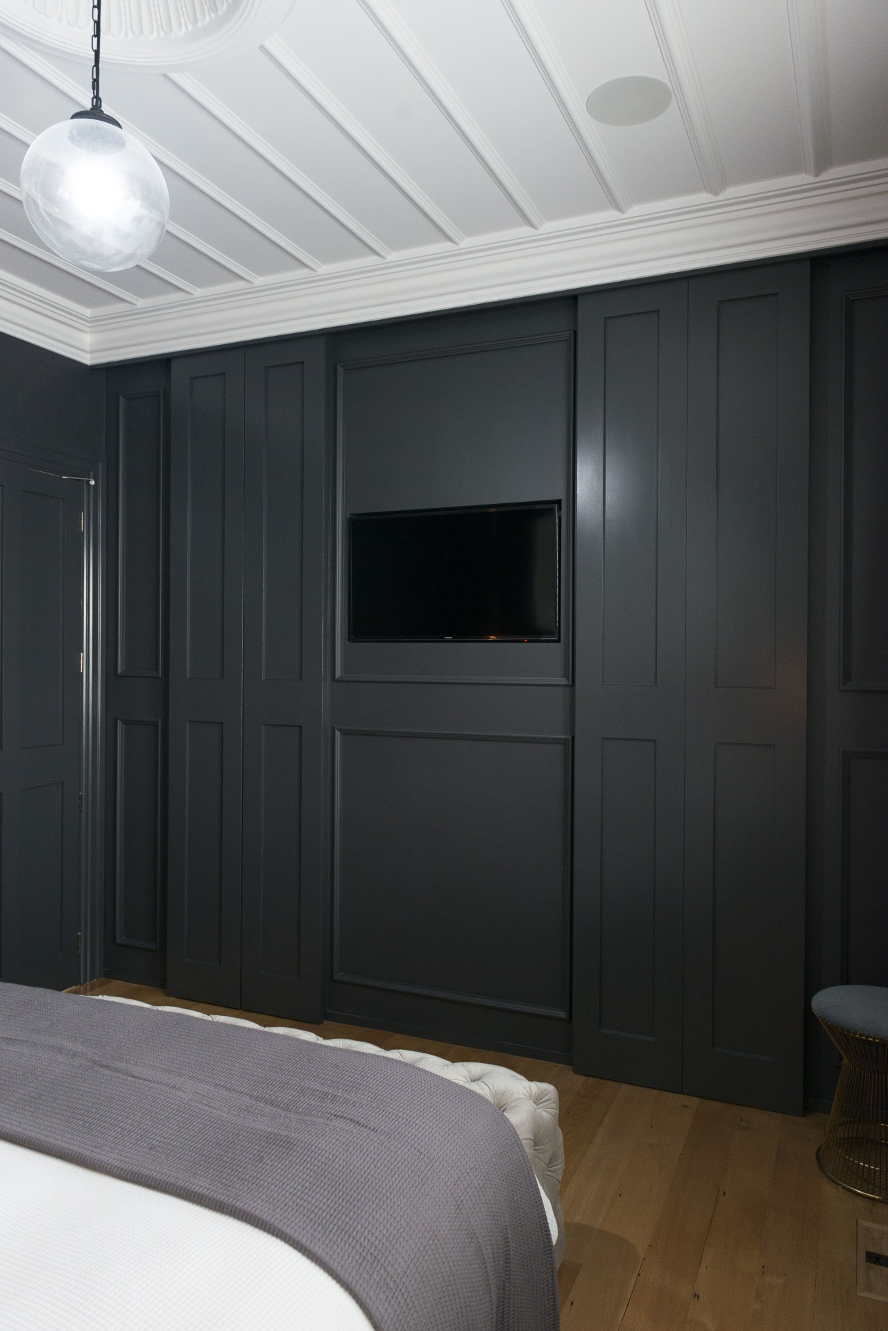 Open sesame dark grey wall panelling disguises the ceiling, door, furniture, interior design, wall, wardrobe, black