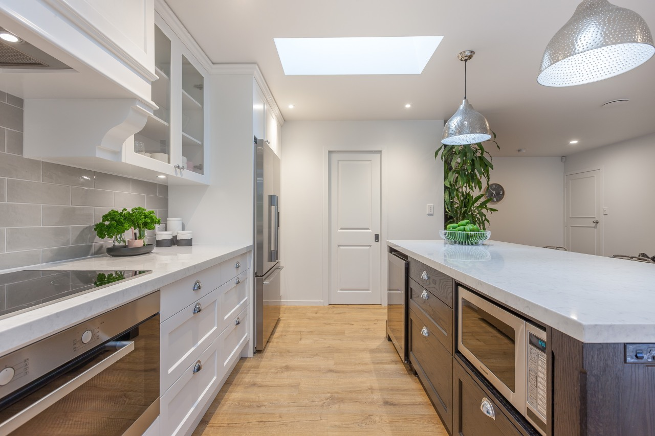 This kitchen renovation by designer Kira Gray offers cabinetry, countertop, home, interior design, kitchen, real estate, room, gray