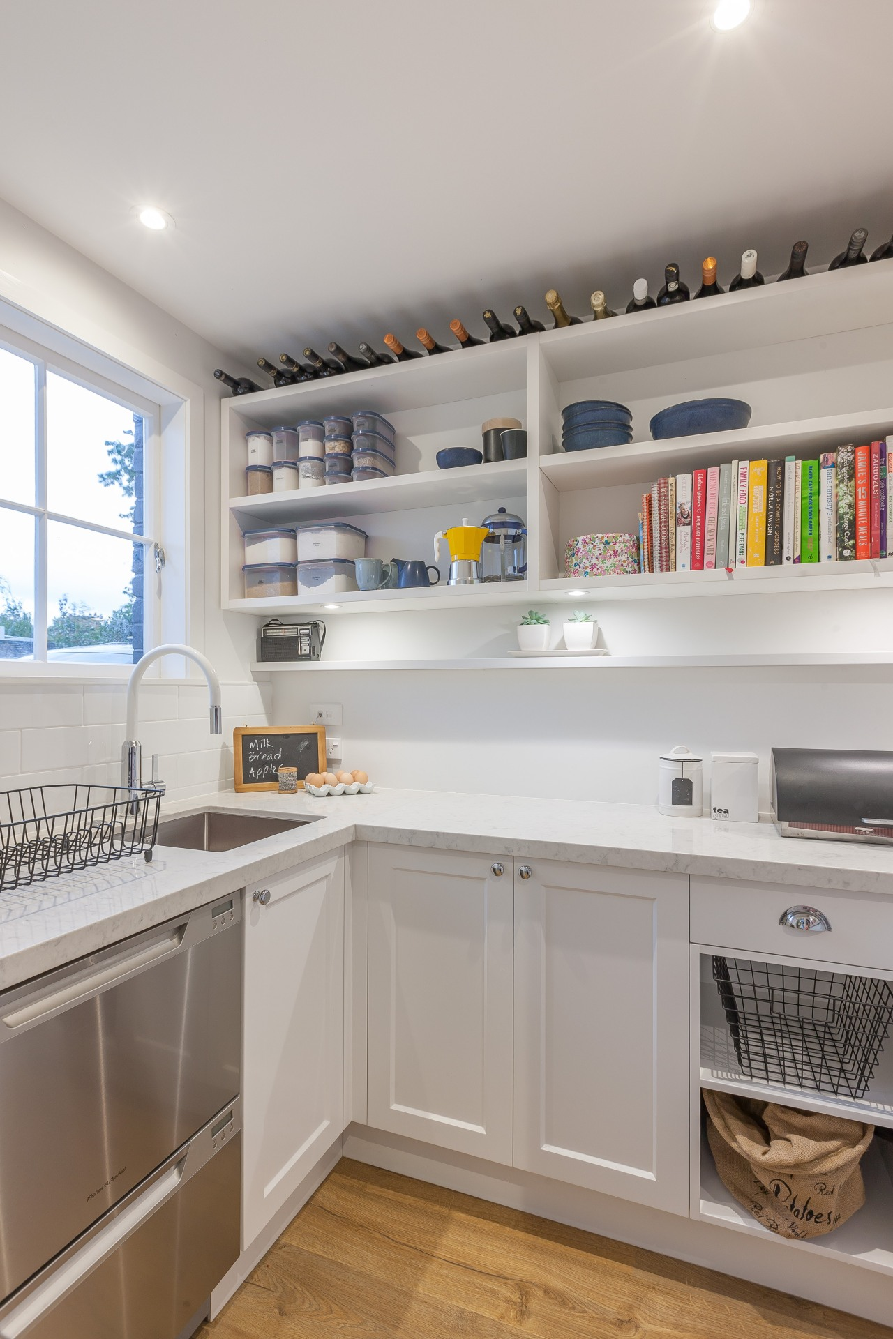 The scullery area in this Kira Gray kitchen cabinetry, countertop, interior design, kitchen, room, shelf, shelving, gray