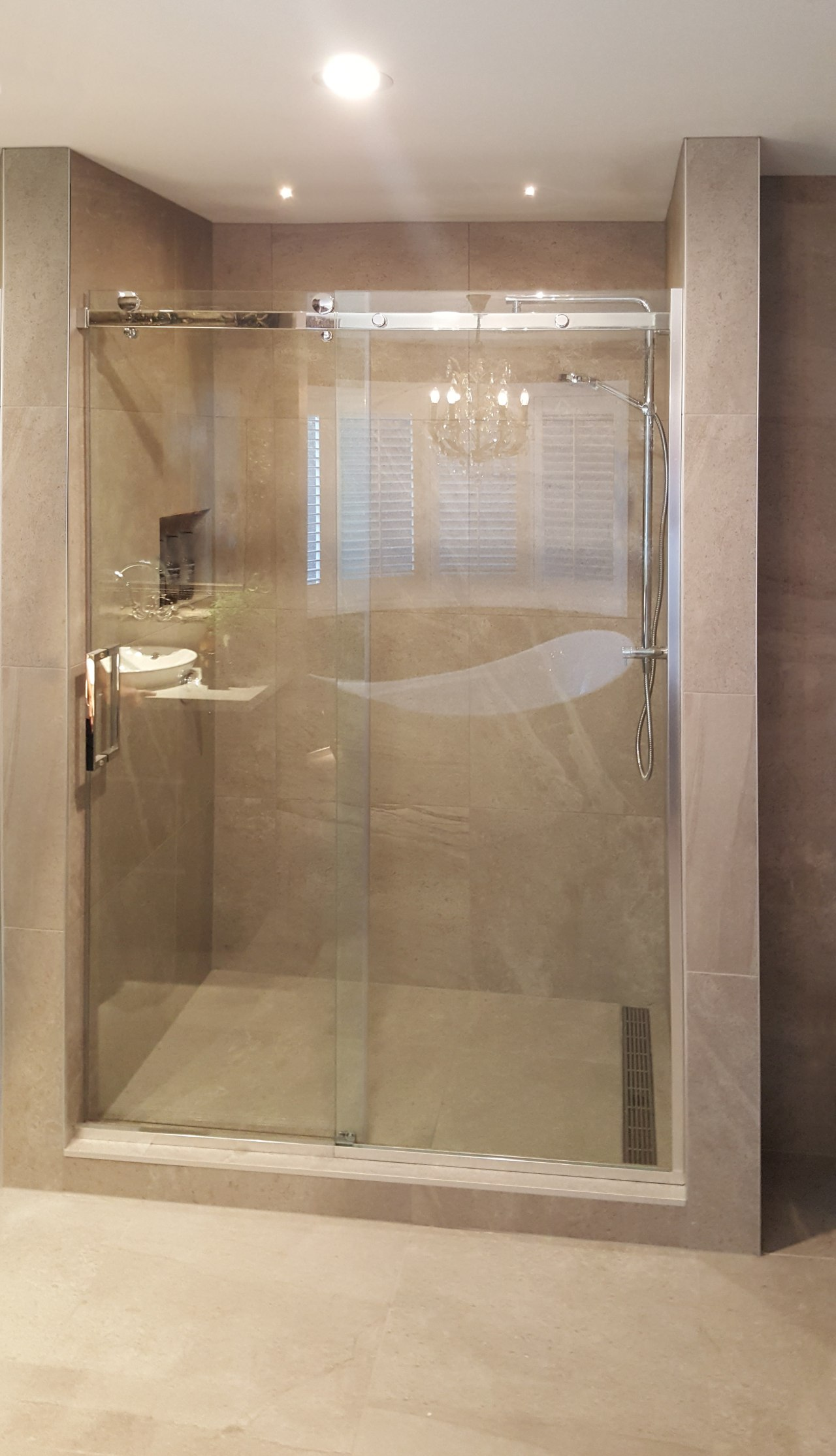 This bathroom by Five Star Bathrooms has many bathroom, plumbing fixture, shower, brown, gray