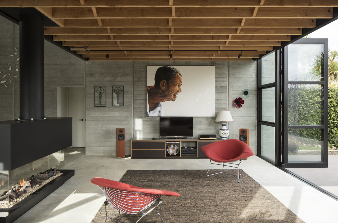 Board-faced concrete panels have been left exposed, providing architecture, house, interior design, living room, black, concrete,