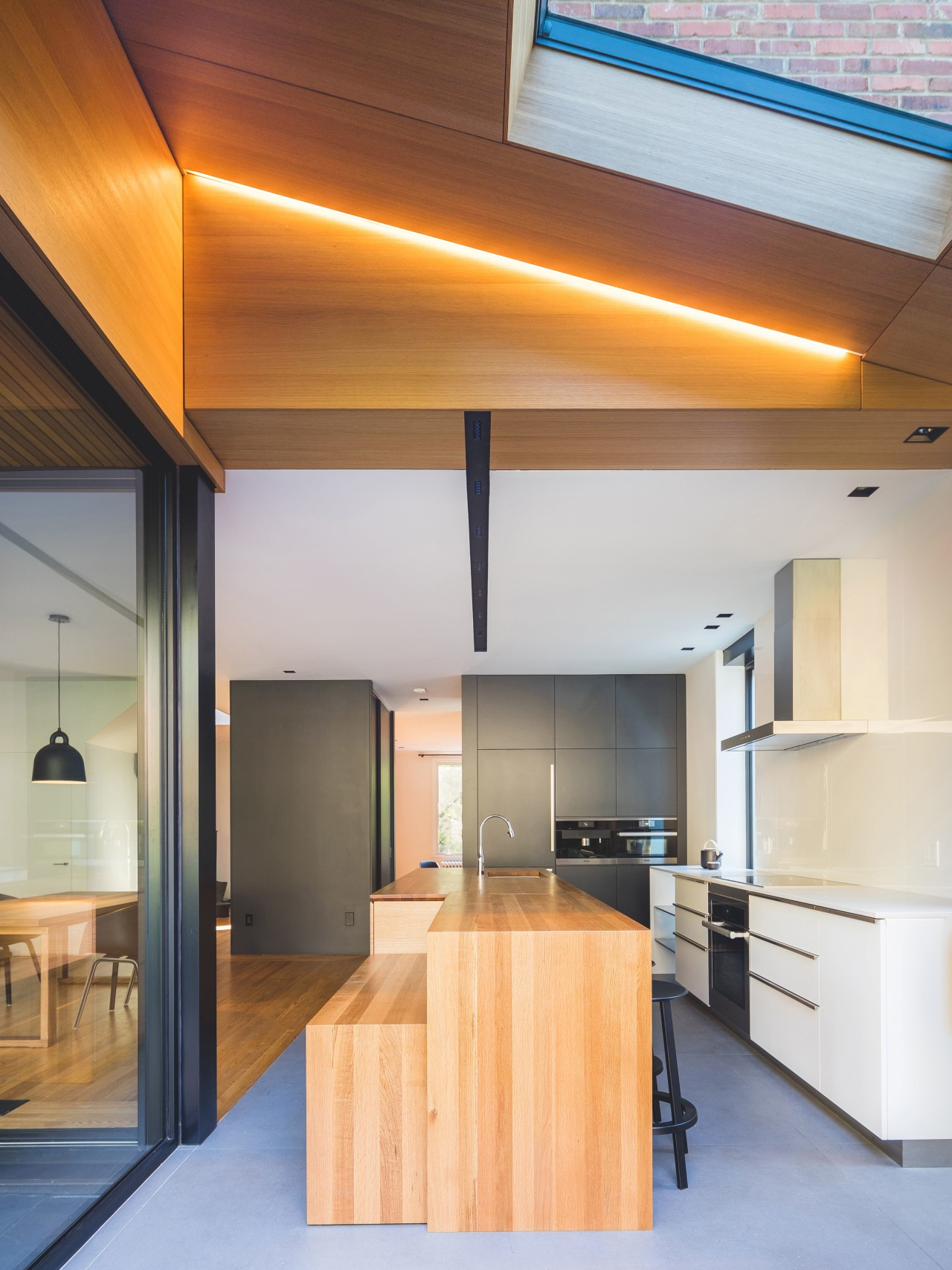 An extension at the back of this 1930s architecture, ceiling, countertop, daylighting, house, interior design, kitchen, lighting, real estate, gray