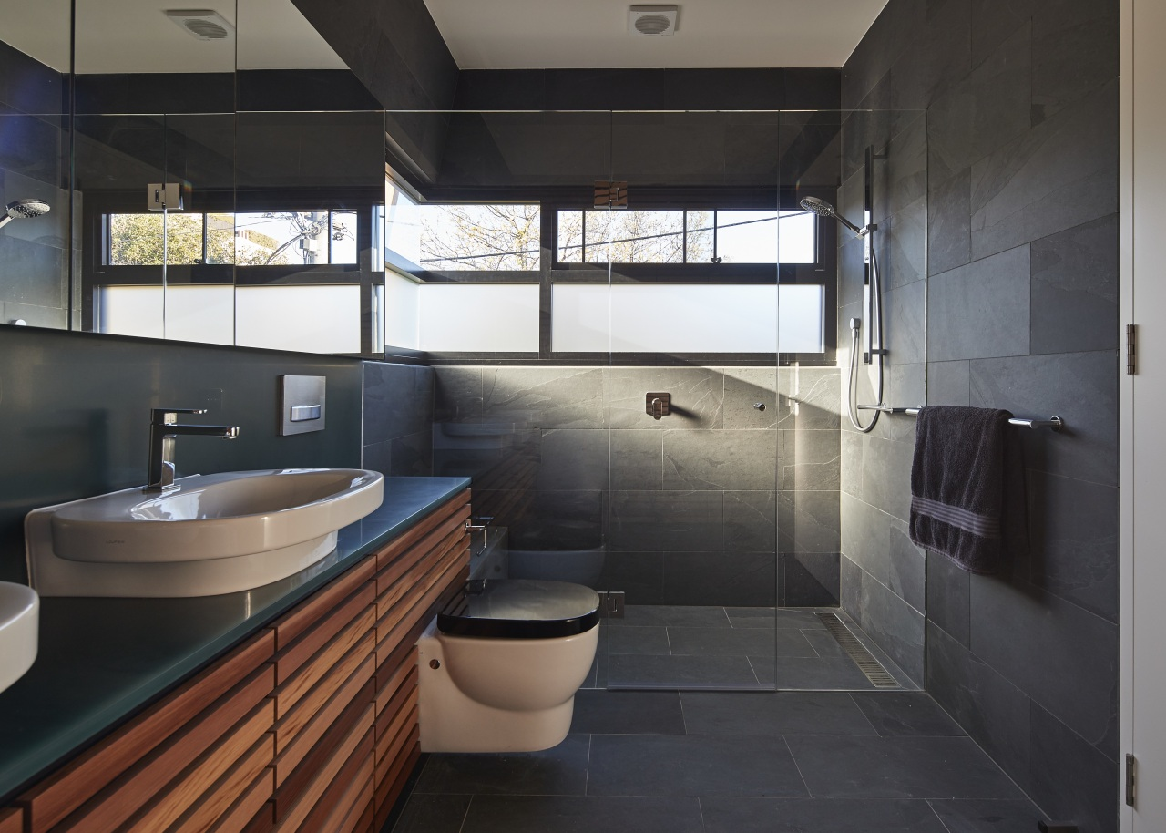 Slate tile flooring and matching wall tiles combine architecture, bathroom, room, black