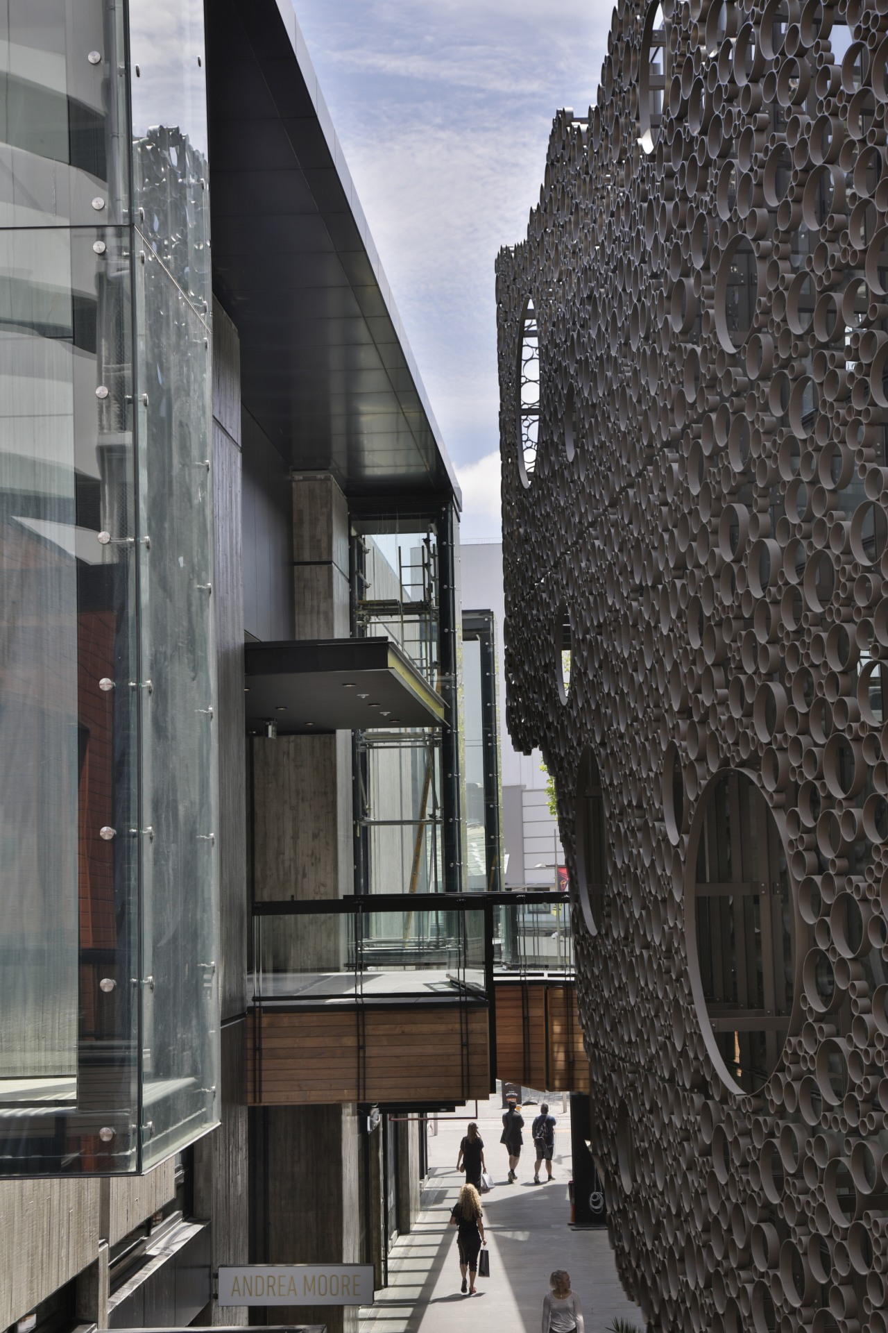 First floor shops and walkways offer glimpses into architecture, building, black, gray