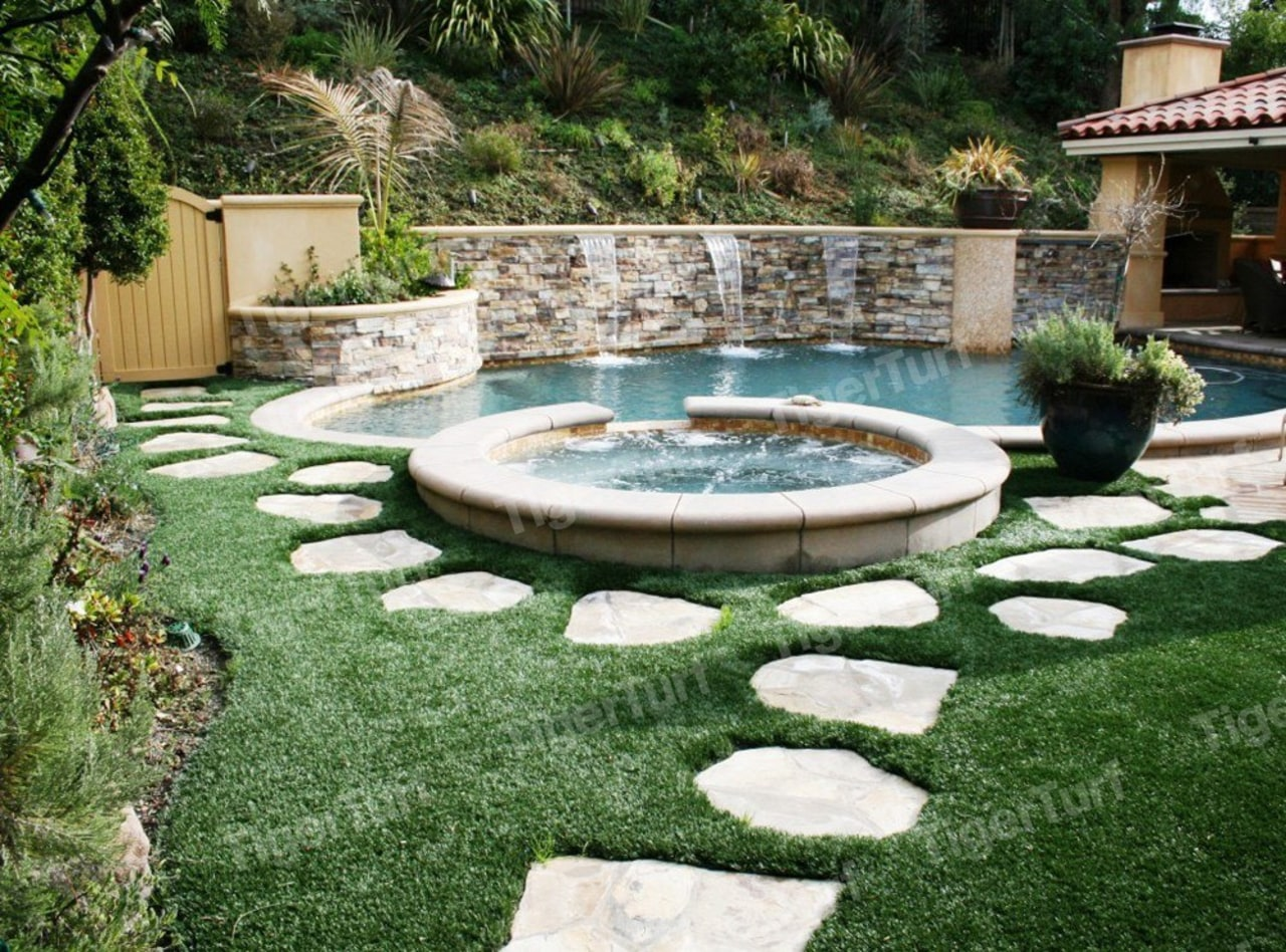 TigerTurf used around pavers looks great and backyard, courtyard, estate, garden, grass, landscape, landscaping, lawn, leisure, outdoor structure, plant, property, swimming pool, water, water feature, yard, green