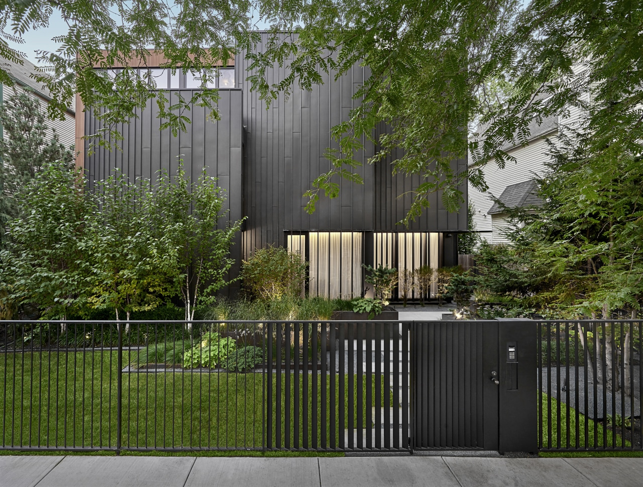 The facade of the home, clad in warm,