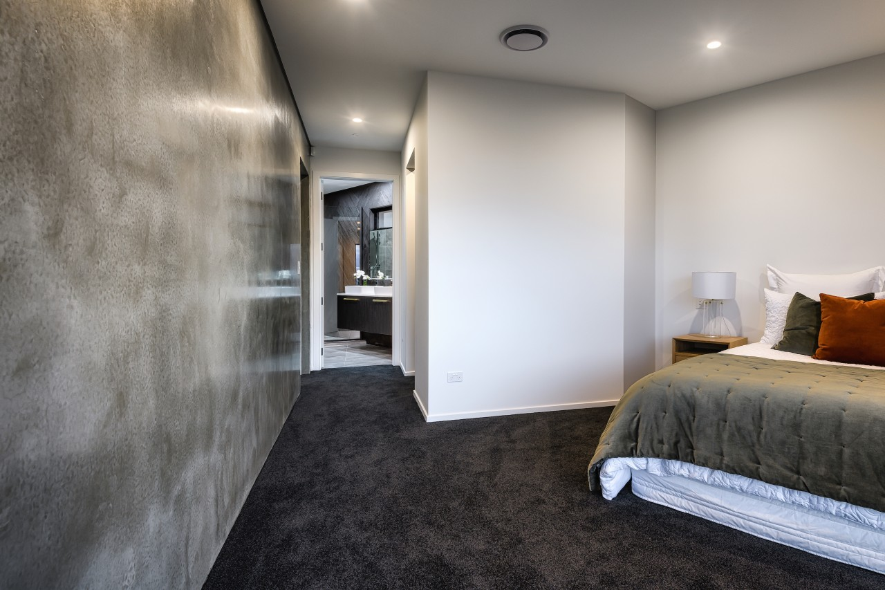 The polished concrete wall is a result of