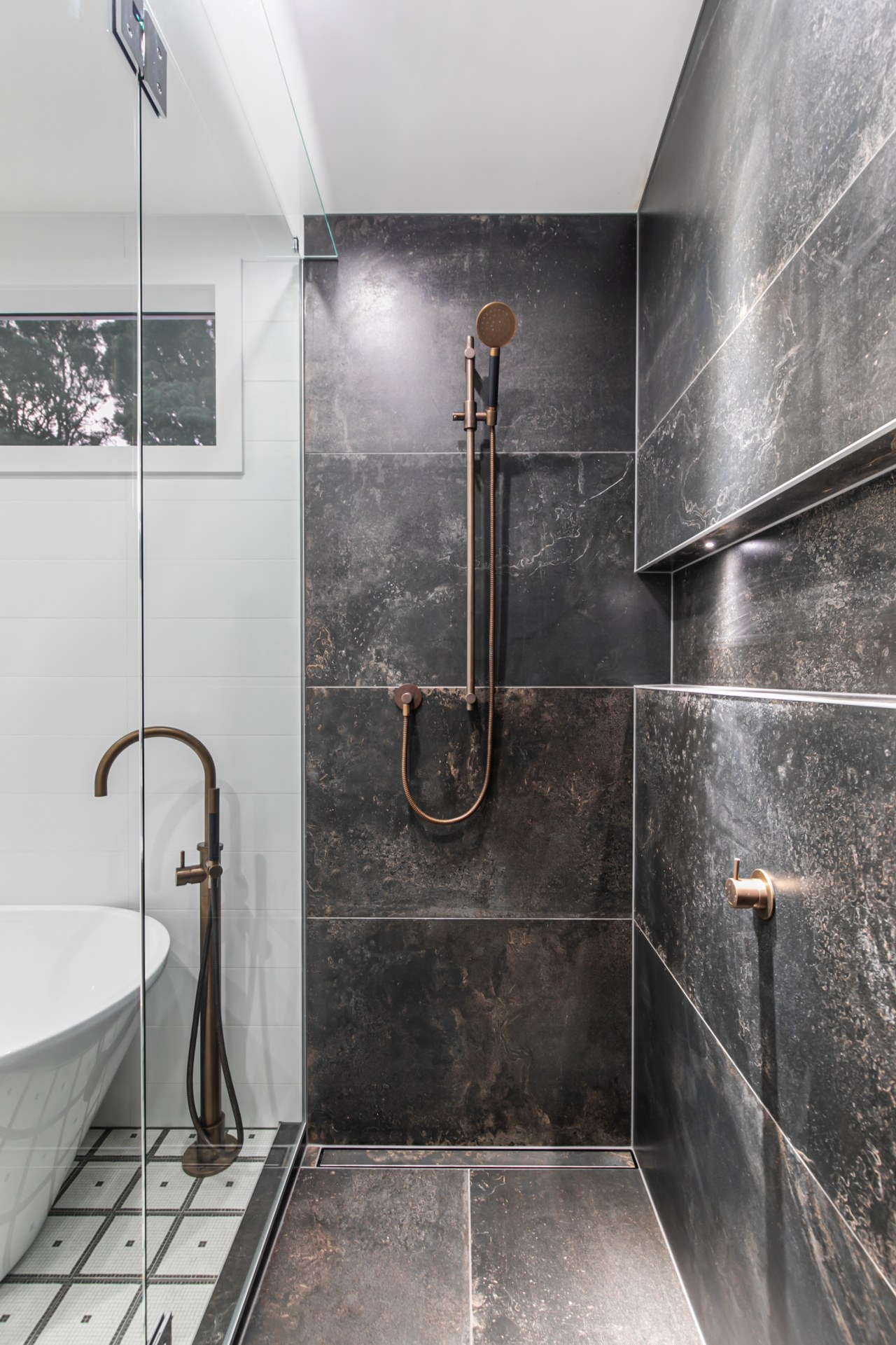 The shower stall from within – tall, dark,