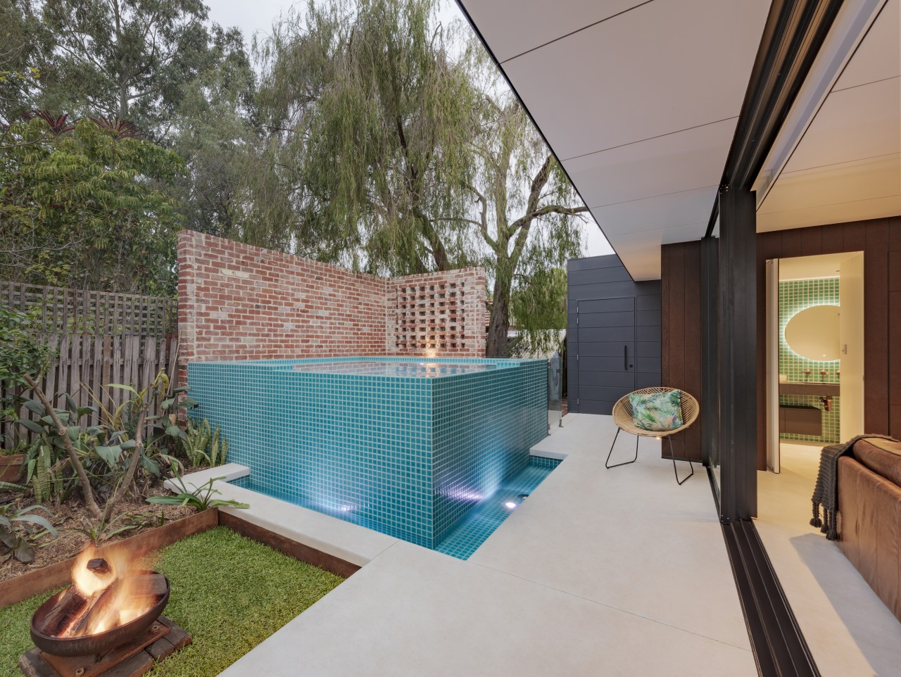 The new above-ground swimming pool has a waterfall