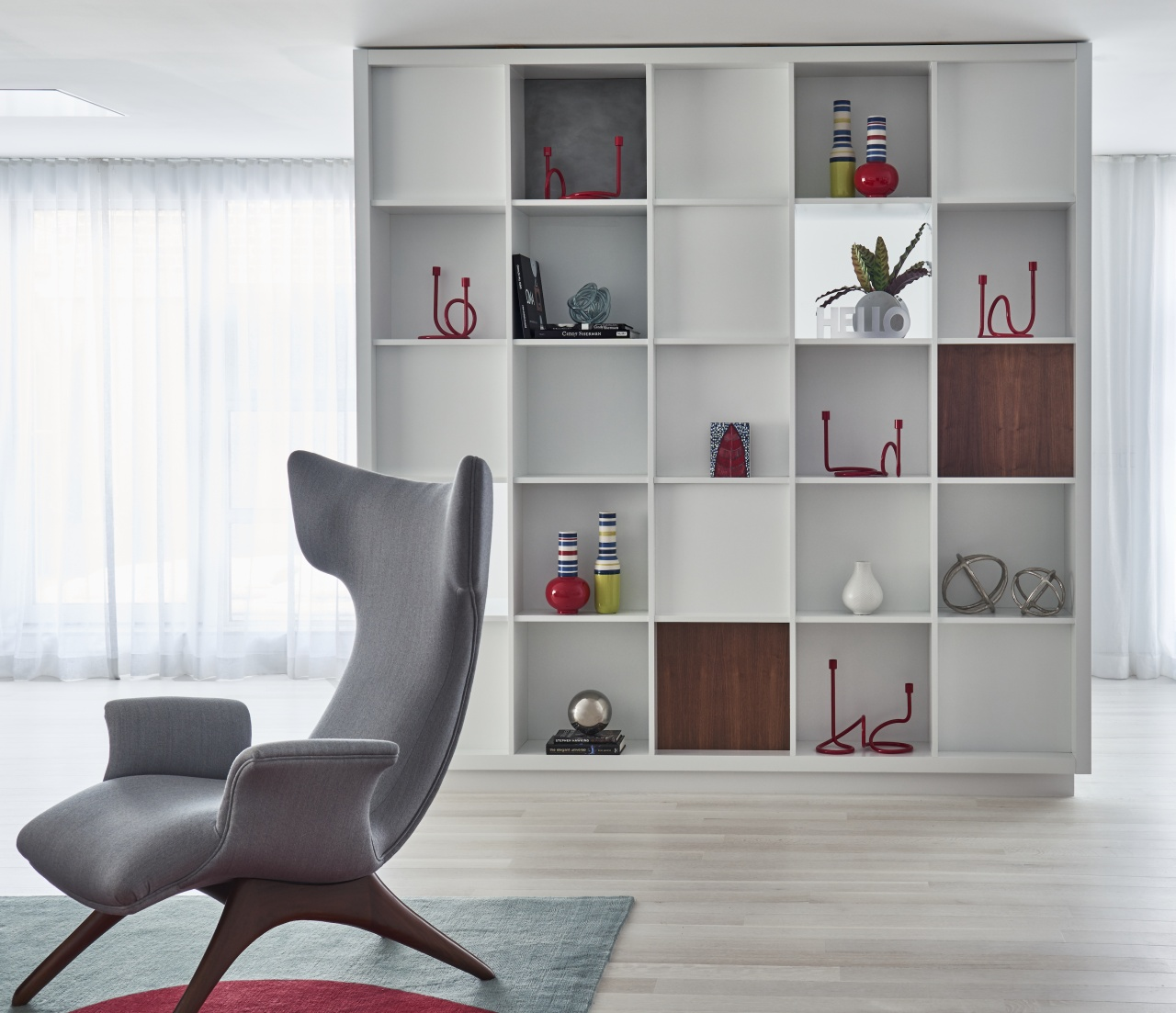 This custom bookcase/room divider was designed based on