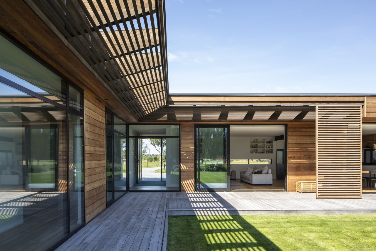 With a covered cedar clad walkway connecting the