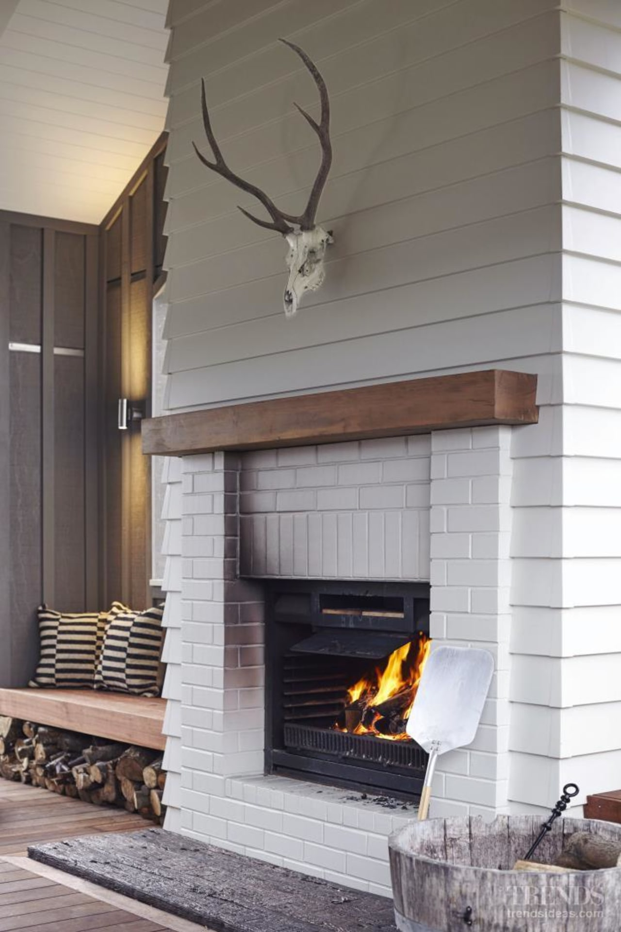 This is one of many classic and contemporary fireplace, hearth, home, interior design, living room, wall, wood burning stove, gray