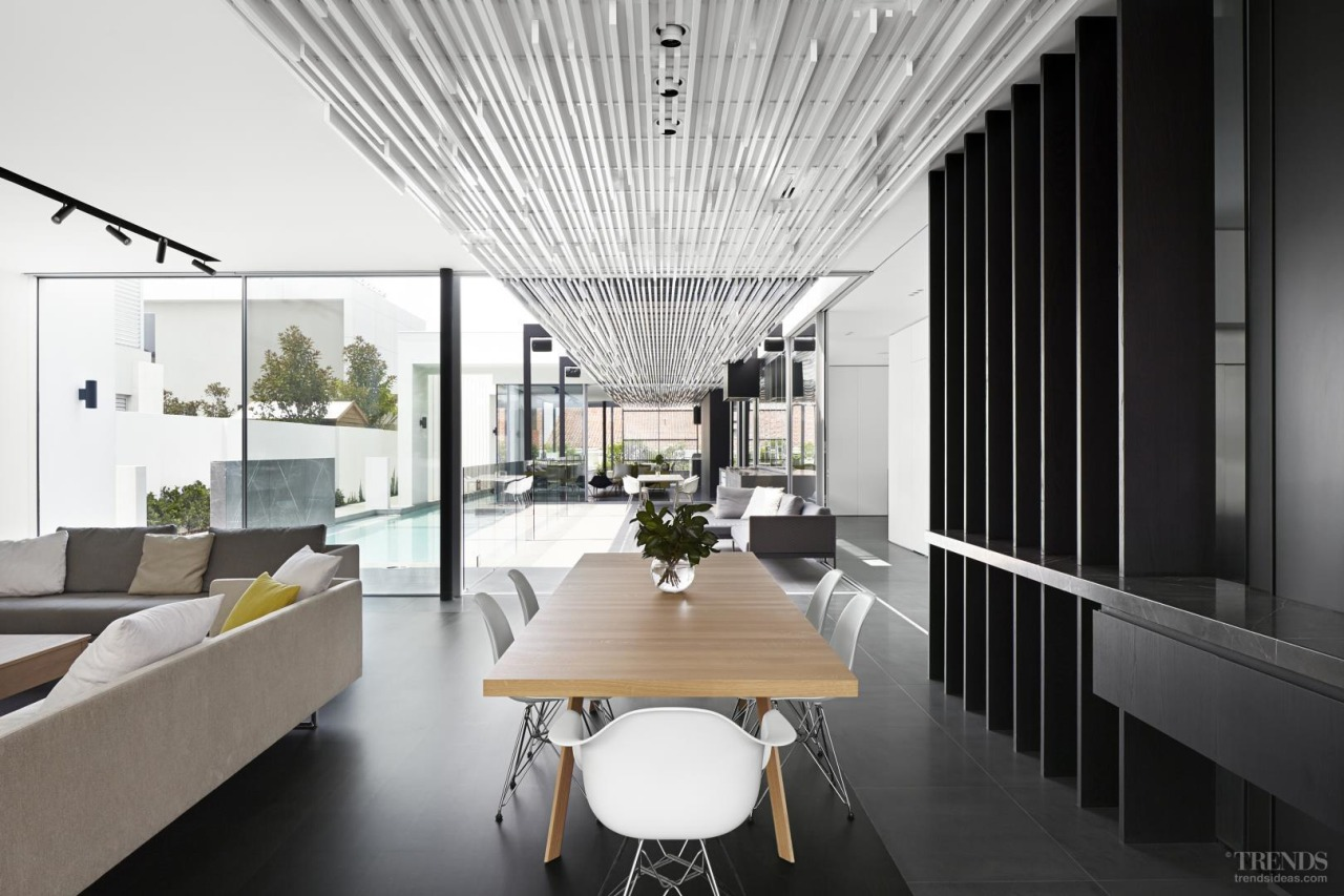 The main axis through this house is defined apartment, architecture, ceiling, condominium, house, interior design, real estate, white, black
