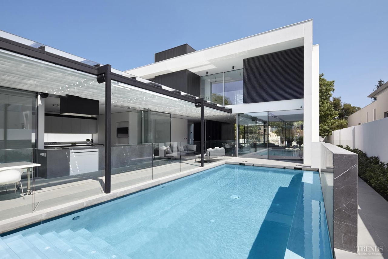 In this home, a swimming pool is positioned architecture, estate, home, house, property, real estate, swimming pool, villa, window, teal