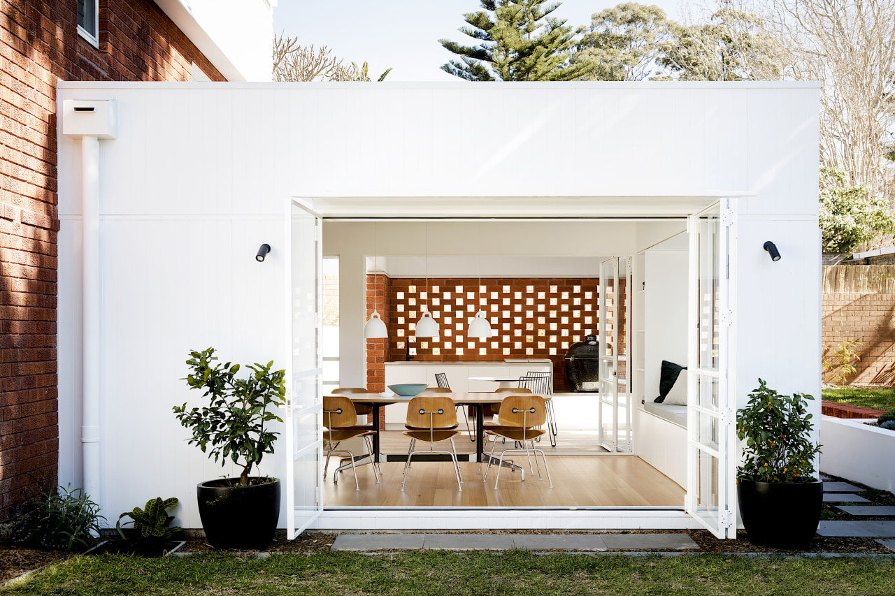 Bifold doors open the dining space to the