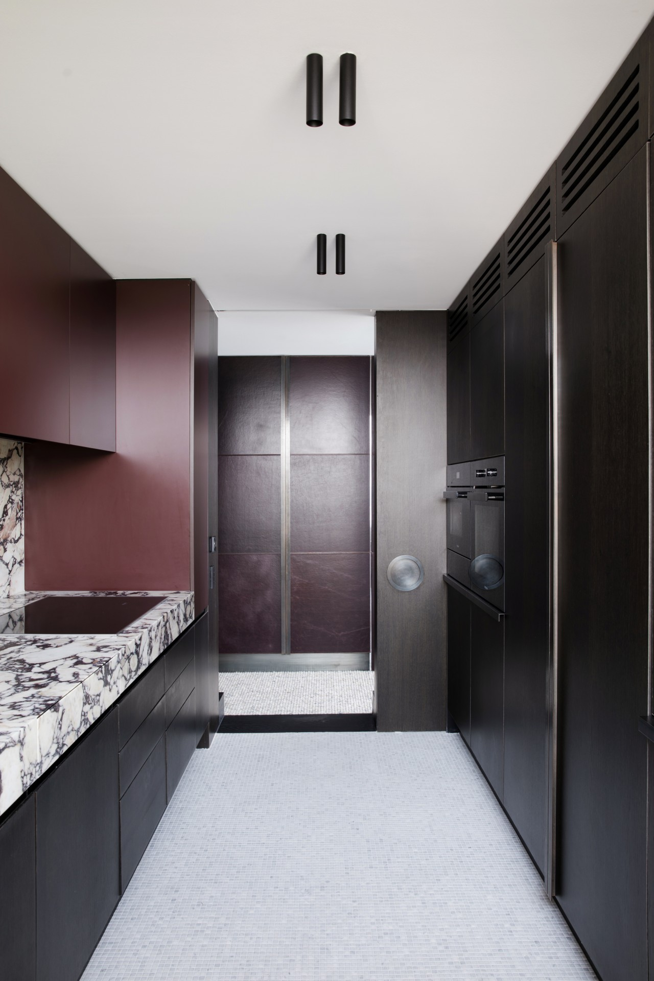 Understated black cabinetry conceals a wealth of functionality.
