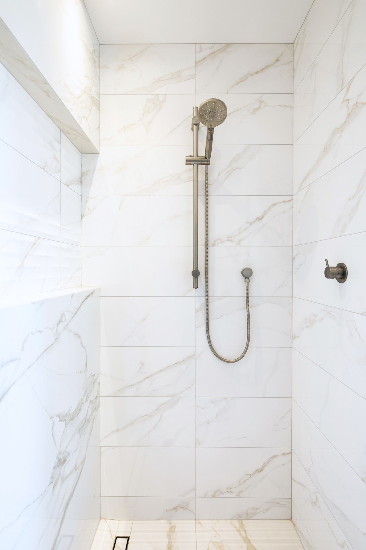 The long custom shower stall includes a soap