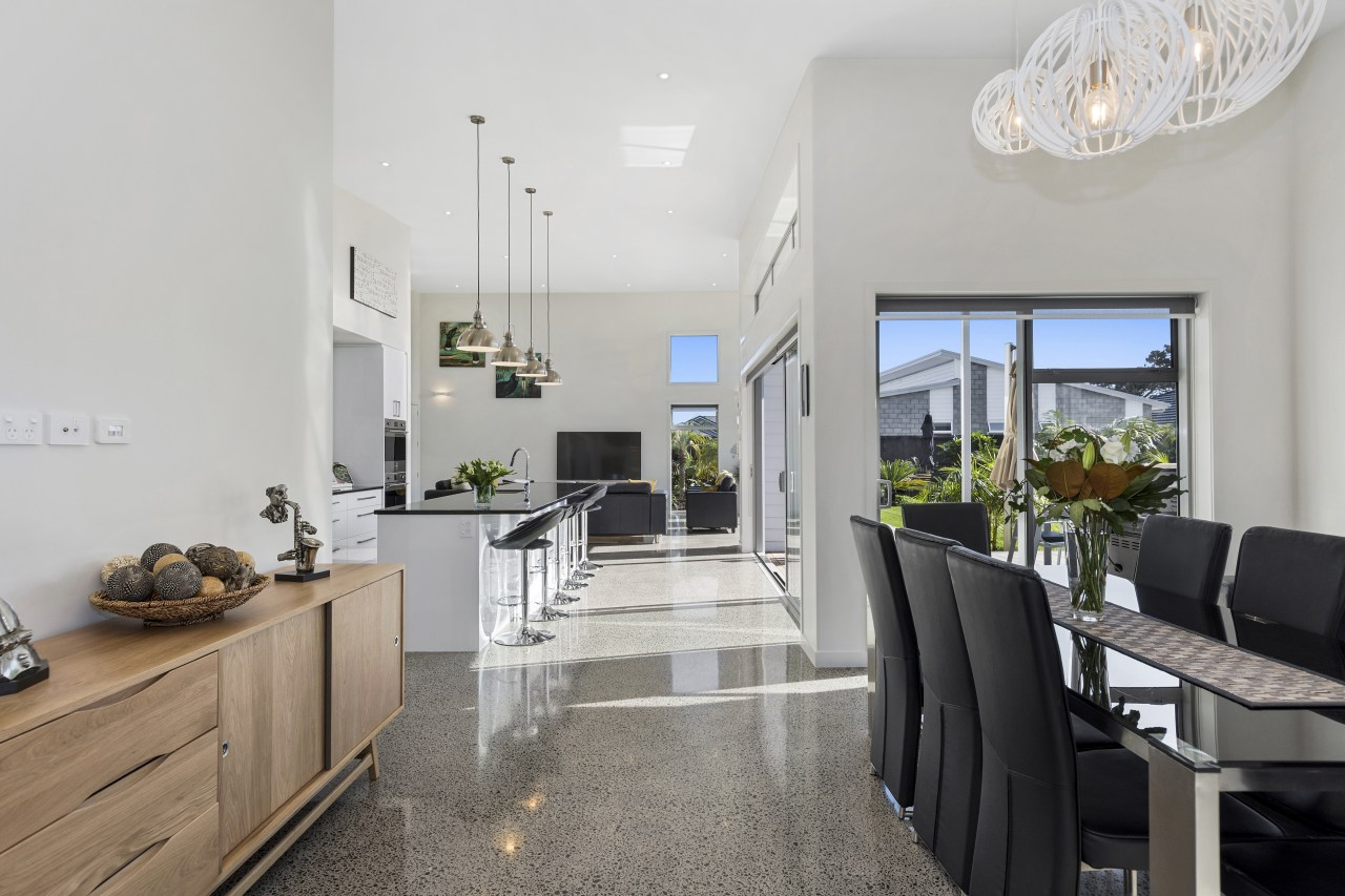 Soaring ceilings and an interior living zone that interior design, property, real estate, gray